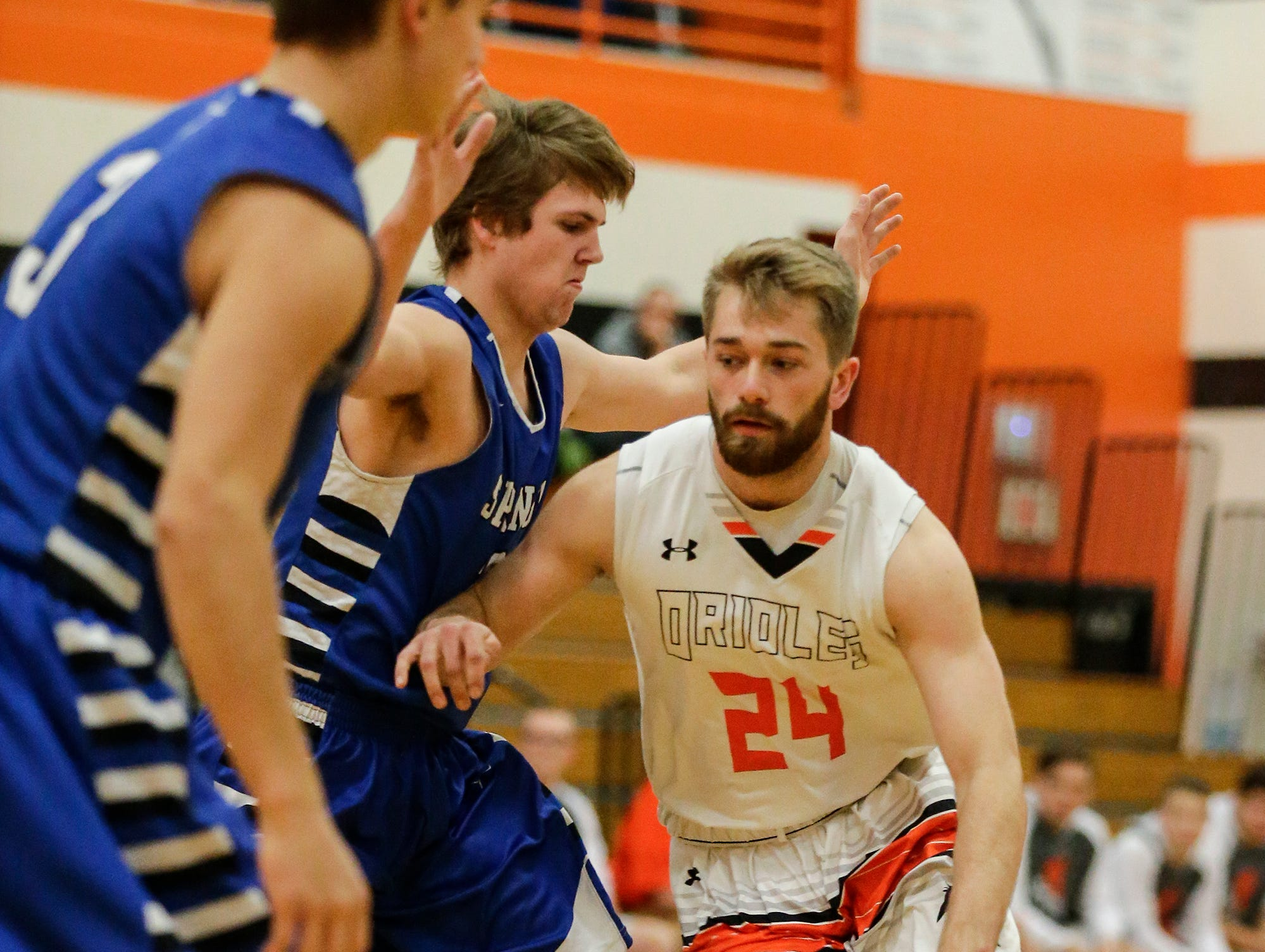 North Fond du Lac High School boys basketball's Alex Zander works his way past St. Mary's Springs Academy's Aiden Ottery during their game Friday, December 7, 2018 in North Fond du Lac, Wisconsin. Doug Raflik/USA TODAY NETWORK-Wisconsin