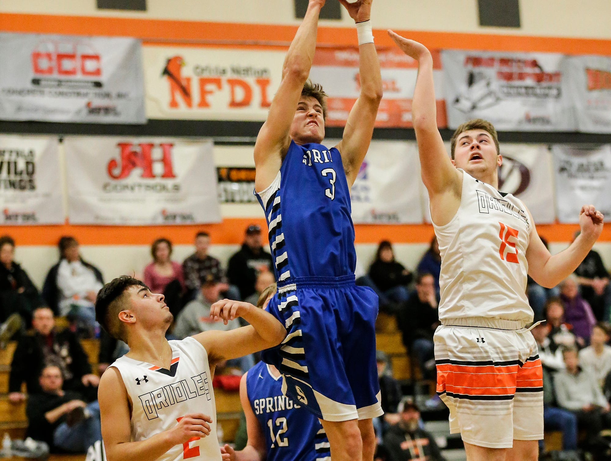 St. Mary's Springs Academy's boys basketball's Mitch Waechter gets this rebound over North Fond du Lac High School's Mathias Gilbertson during their game Friday, December 7, 2018 in North Fond du Lac, Wisconsin. Doug Raflik/USA TODAY NETWORK-Wisconsin