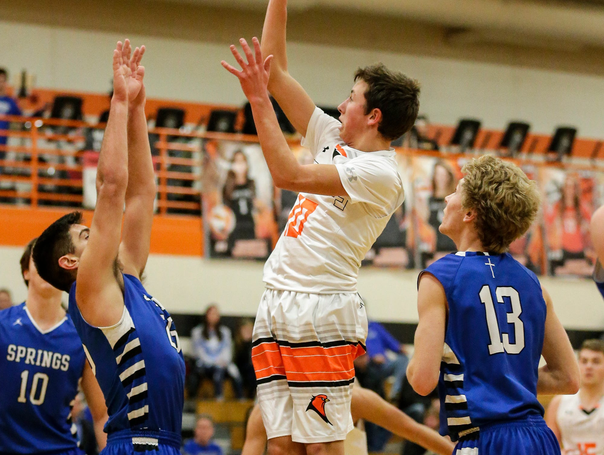 North Fond du Lac High School boys basketball's Dakota Krupp shoots a basket over St. Mary's Springs Academy's Justin Ditter during their game Friday, December 7, 2018 in North Fond du Lac, Wisconsin. Doug Raflik/USA TODAY NETWORK-Wisconsin