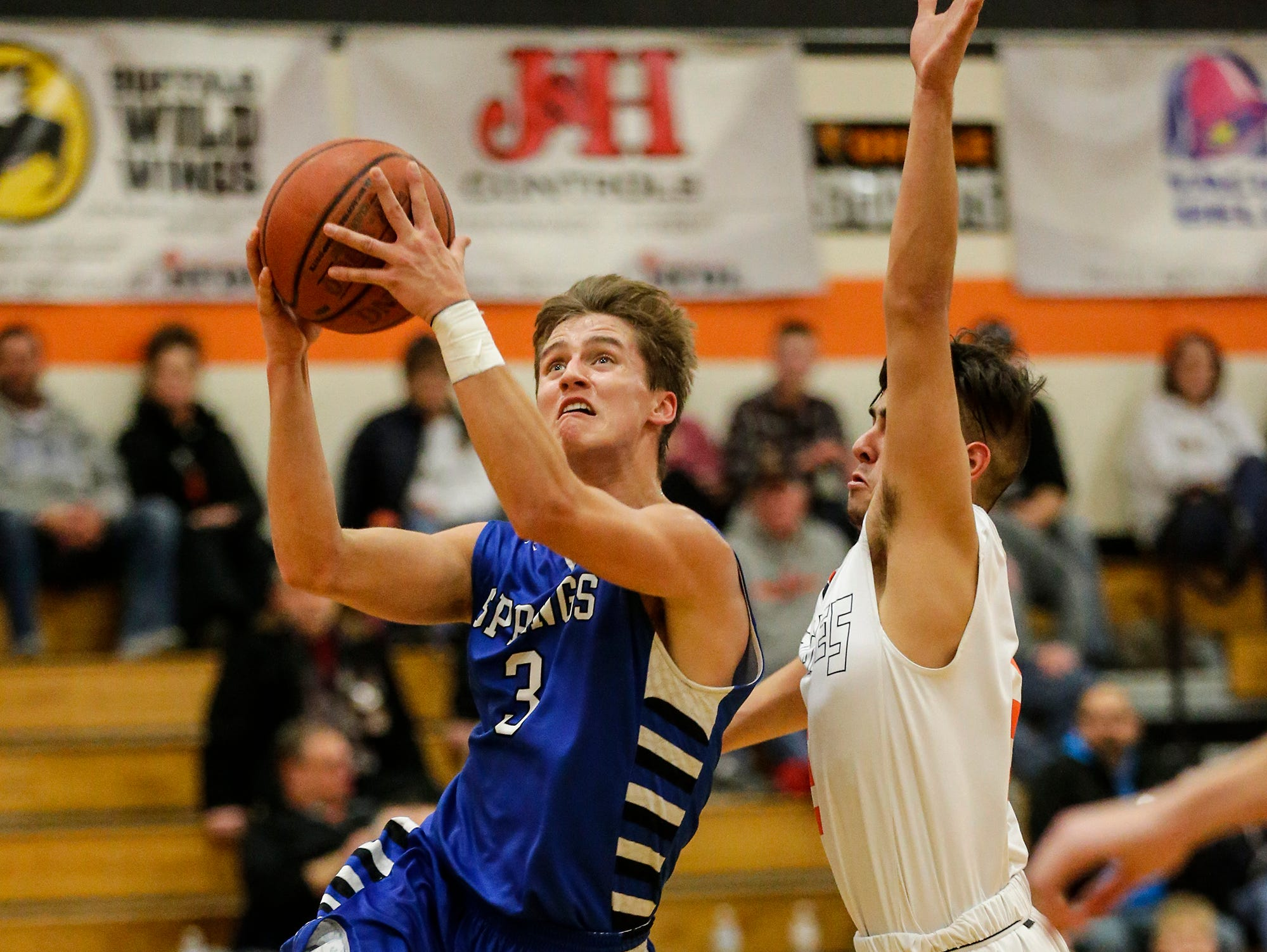 St. Mary's Springs Academy's boys basketball's Mitch Waechter goes up for a basket against North Fond du Lac High School's Tony Reyes during their game Friday, December 7, 2018 in North Fond du Lac, Wisconsin. Doug Raflik/USA TODAY NETWORK-Wisconsin
