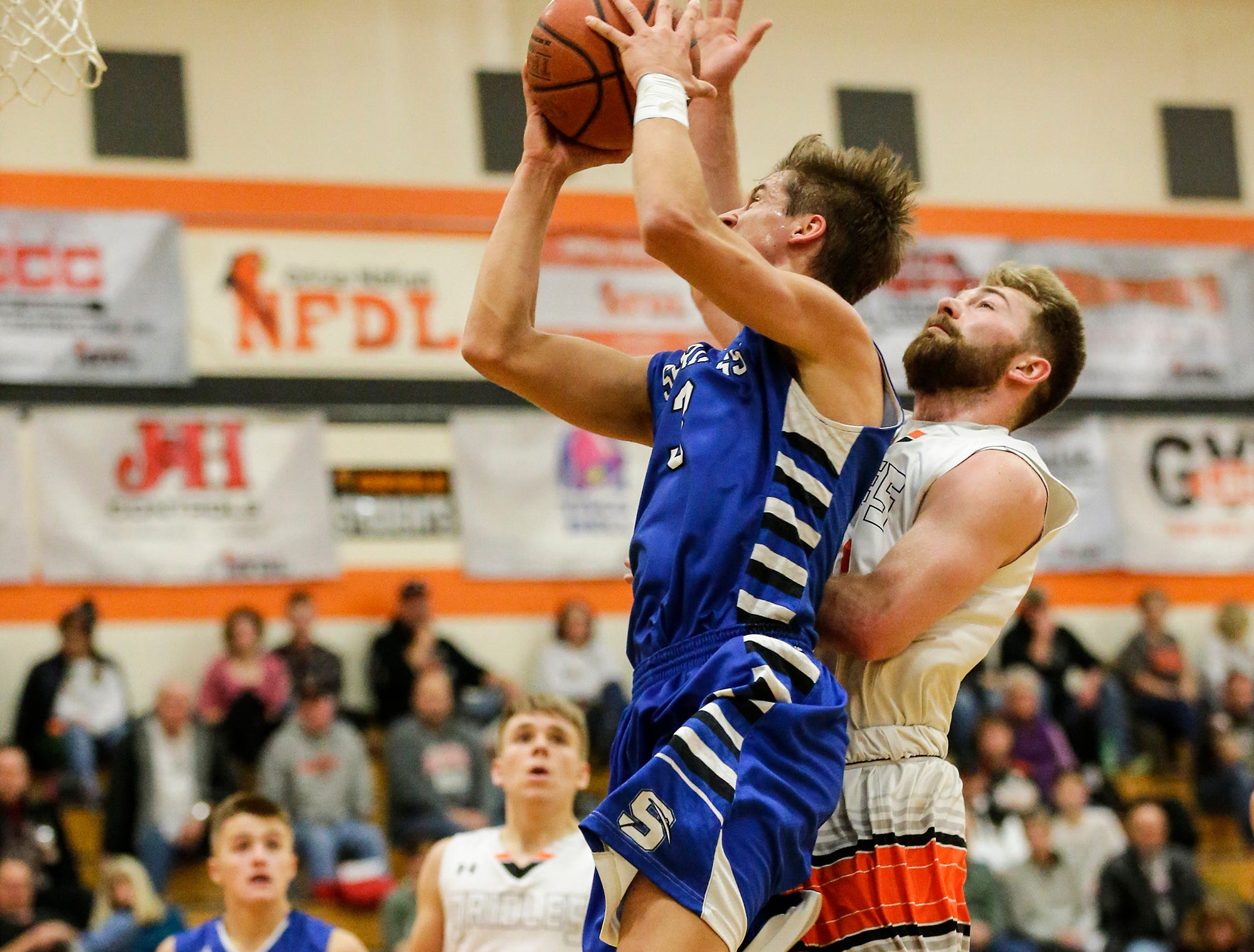 North Fond du Lac High School boys basketball's Alan Ayala fouls St. Mary's Springs Academy's Mitch Waechter during their game Friday, December 7, 2018 in North Fond du Lac, Wisconsin. Doug Raflik/USA TODAY NETWORK-Wisconsin