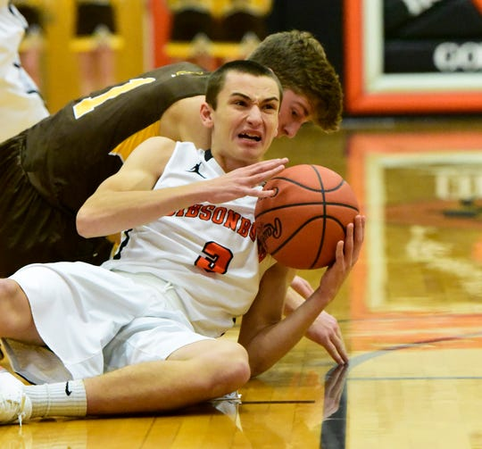 Gibsonburg's Mitch Tille scraps for a loose ball against Old Fort.
