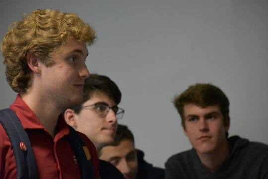 SGA Senator Griffin Leckie and other members of the SLA discuss worker's rights in sweatshops producing FSU apparel.