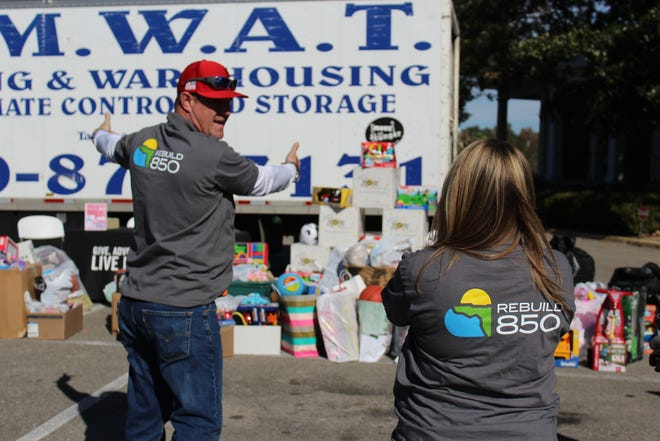 Dean Pugh of AMWAT Moving Warehousing & Storage plans out the loading of the Fill-A-Truck with the collected toys.