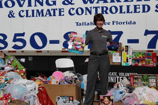 Gwen Graham, former congresswoman and co-chair of REBUILD 850, holds toys that will be donated to children in Panama City.