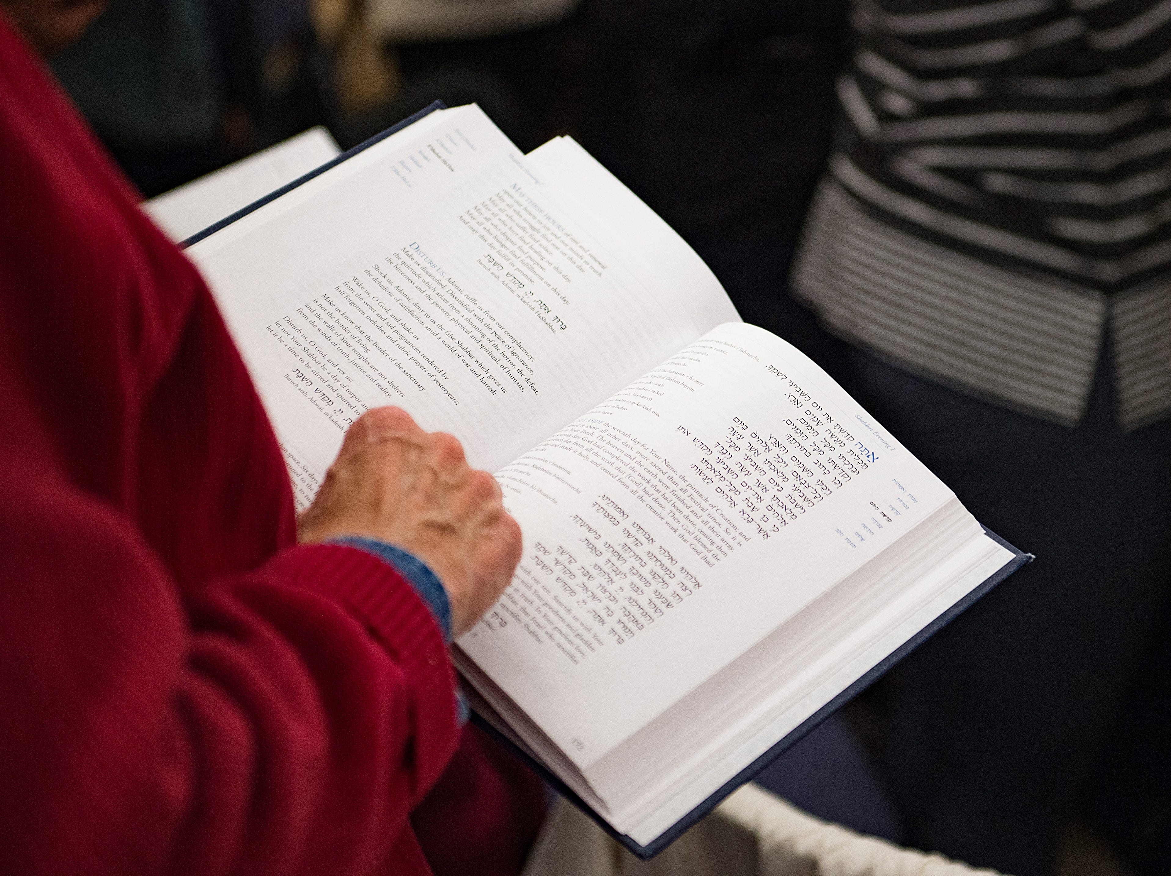 Songs and prayers are read during Shabbat services on the sixth night of Hanukkah during a family gathering with Temple Or Hadash at the Fort Collins Senior Center on Friday, December 7, 2018.