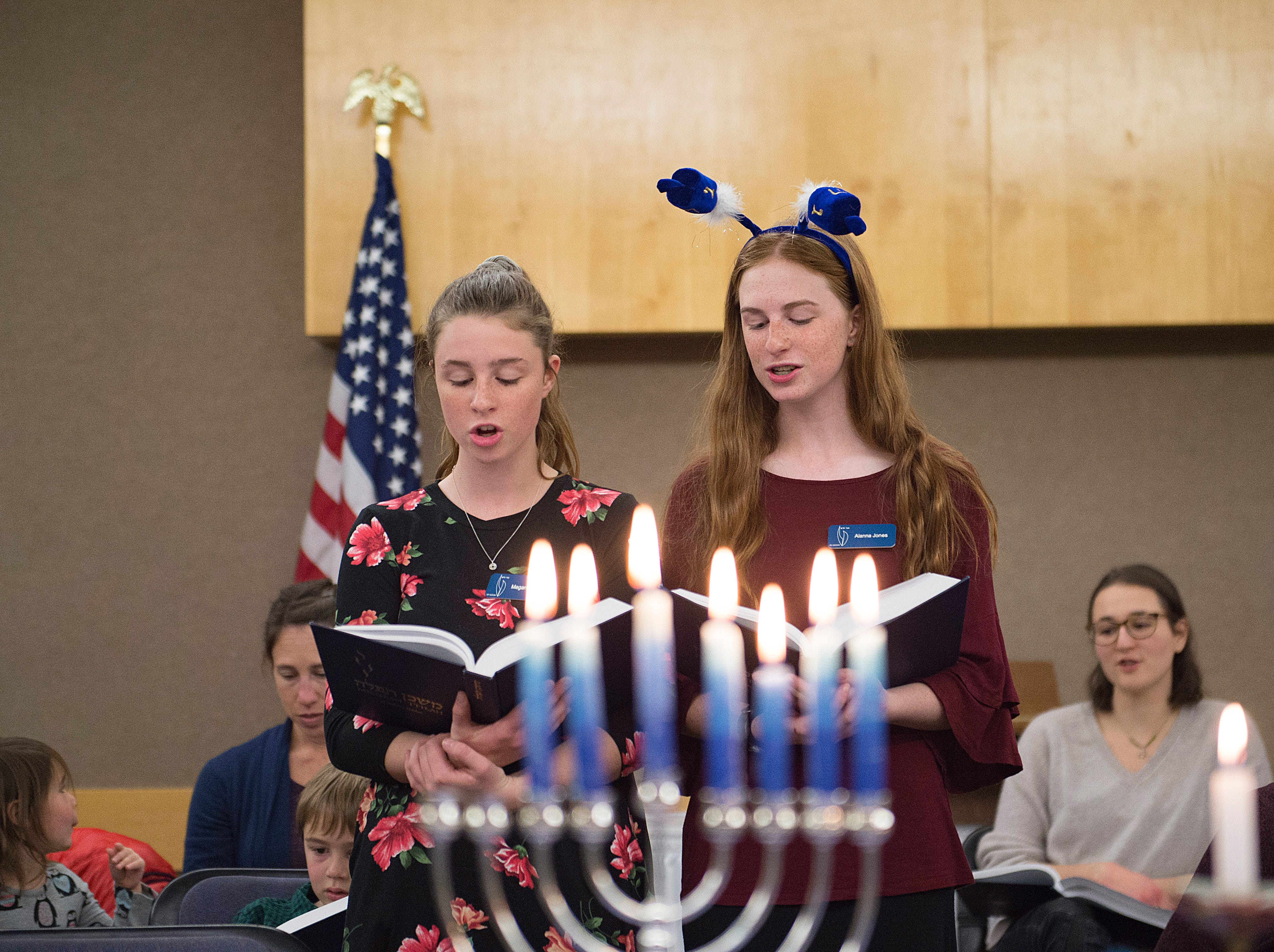 Megan and Alanna Jones lead the congregation in song on the sixth night of Hanukkah during a family gathering with Temple Or Hadash at the Fort Collins Senior Center on Friday, December 7, 2018.