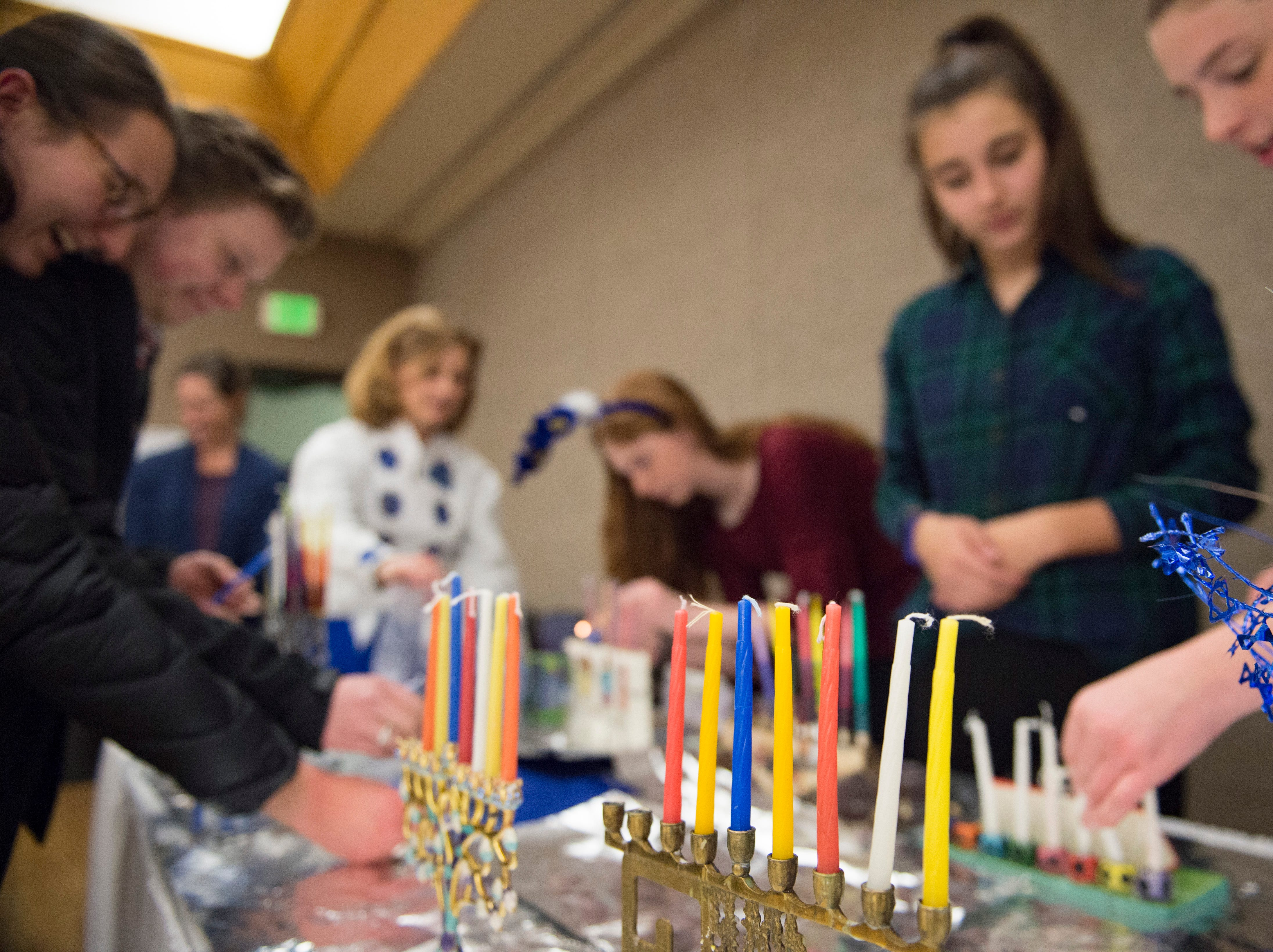 Menorahs are prepared on the sixth night of Hanukkah during a family gathering with Temple Or Hadash at the Fort Collins Senior Center on Friday, December 7, 2018.