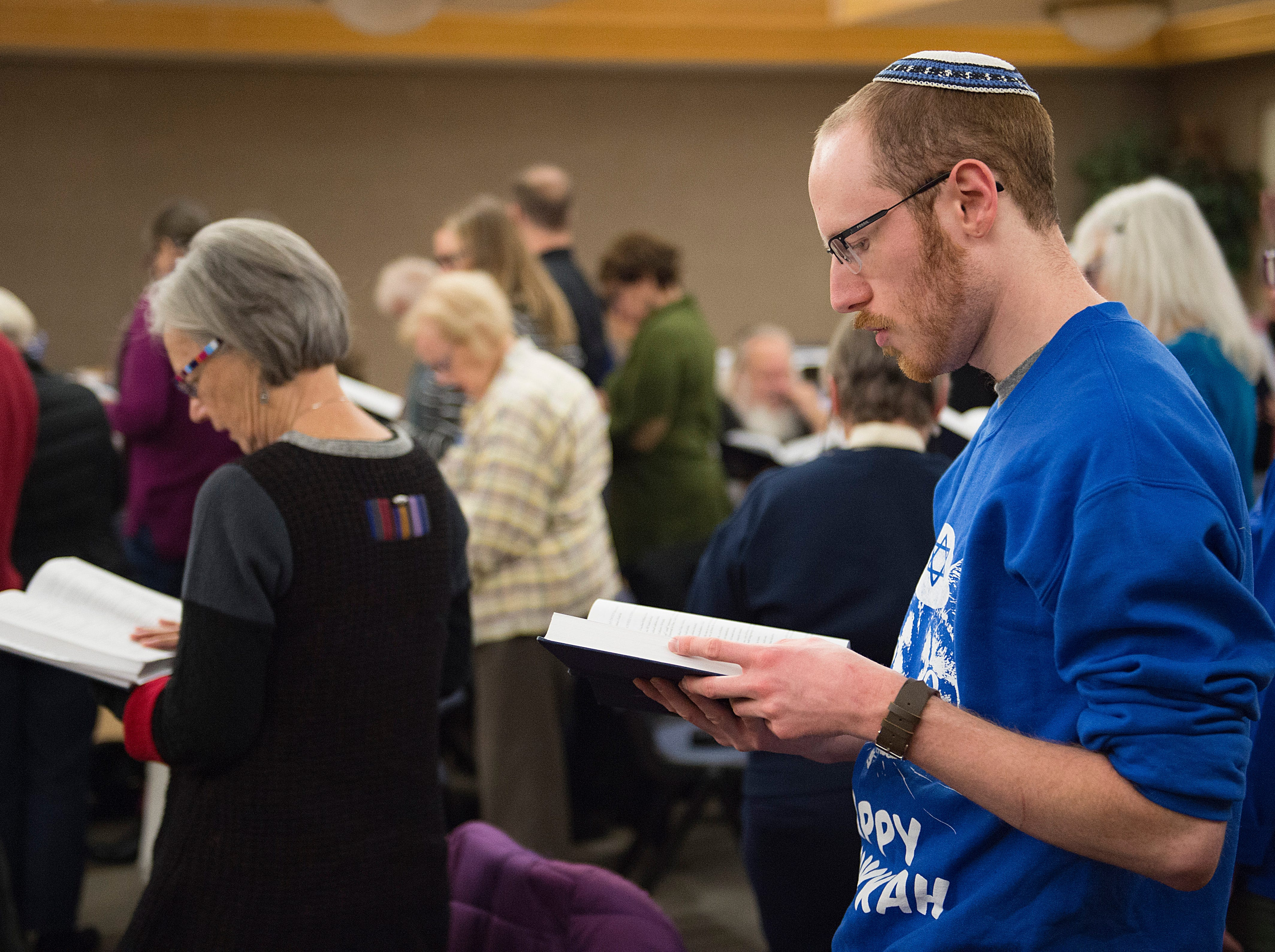 Dan Elliott sings along during Shabbat services on the sixth night of Hanukkah during a family gathering with Temple Or Hadash at the Fort Collins Senior Center on Friday, December 7, 2018.