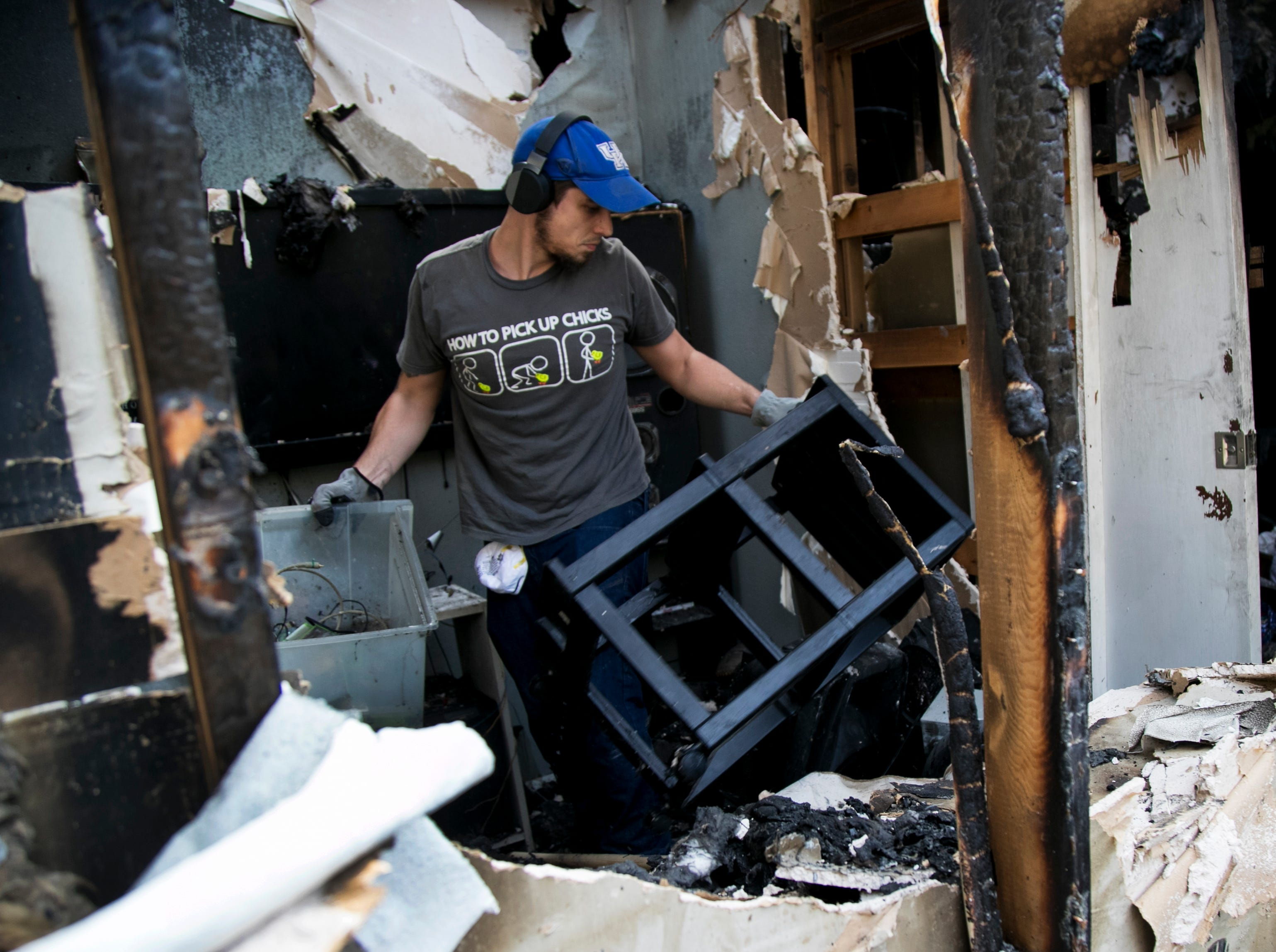 Hunter Bablitz searches for personal items at the Brockington home on Satruday, December 8, 2018, in Fort Myers. Bablitz and other volunteers from The Church of Jesus Christ of Latter Day Saints and from Edison Park Elementary School helped the Brockingtons salvage what they could.