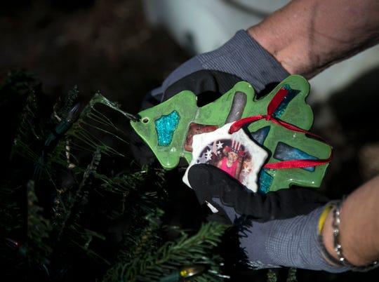 Joyce Palmer saves some of the Christmas orgaments hanging on the Brockingtons' Christmas tree.