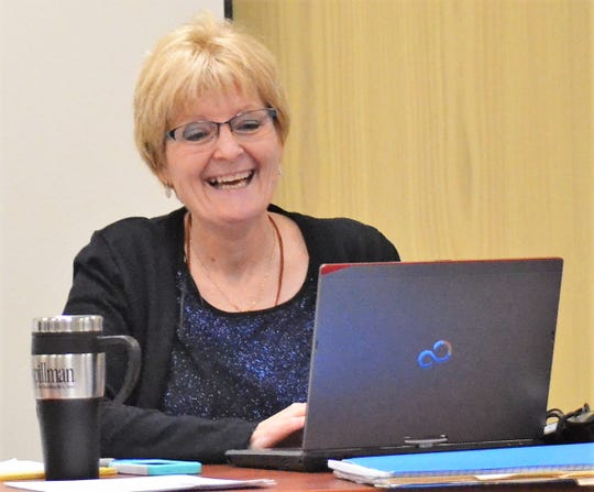 Karen LeFevre, the outgoing adminstrative assistant, smiles at he Dec. 5 meeting of the Oconto County Law Enforcement/Judiciary Committee meeting.