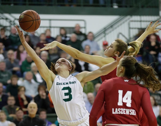Green Bay Phoenix guard Frankie Wurtz (3) drives past the block attempt of guard Alex Luehring (44) against Wisconsin at the Kress Center, Saturday, December 8, 2018 in Green Bay, Wis.