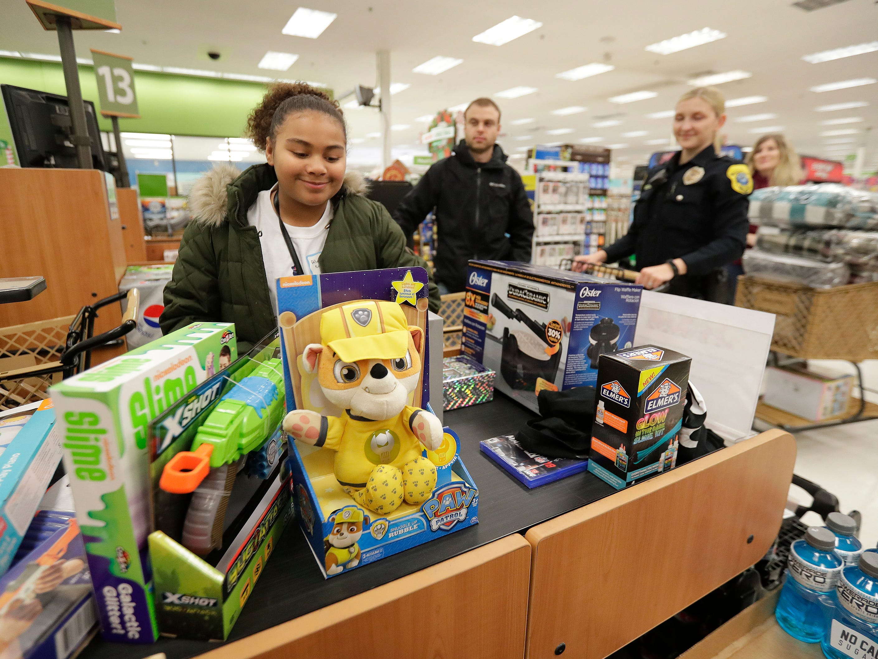 Green Bay Police Department Officers purchase gifts selected with their Shop with A Cop program money at Shopko on East Mason Street December 8, 2018 in Green Bay, Wis.