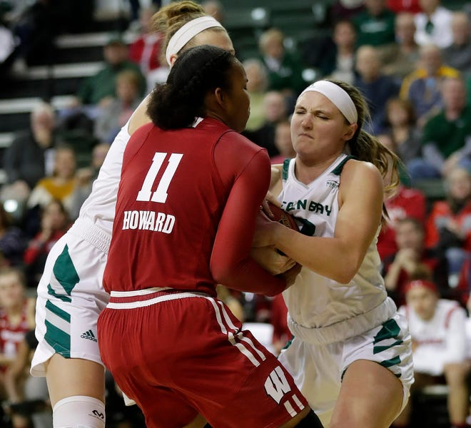 UWGB senior guard Frankie Wurtz, pictured in a game against Wisconsin, had two key blocks late to help lead the Phoenix to a win over IUPUI on Sunday. She also recorded 1,000 career points in the victory.