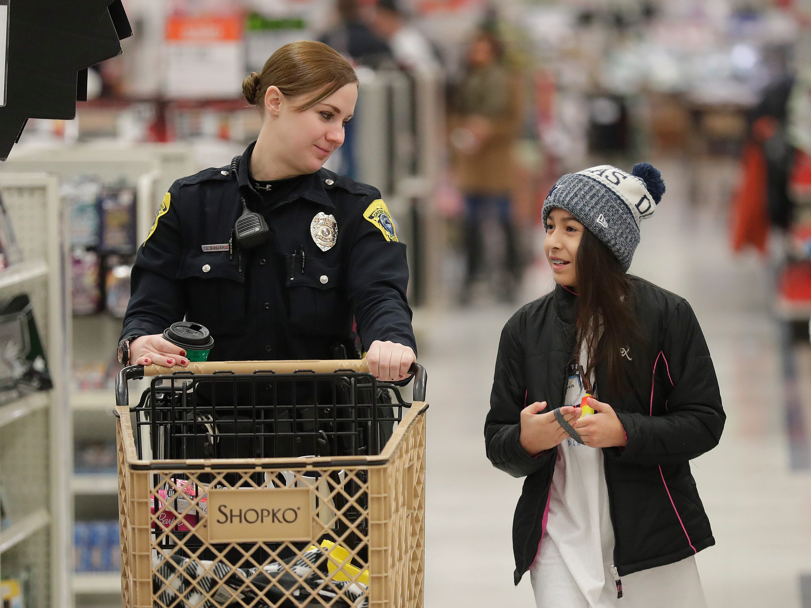 Green Bay Police Department Officer Sheila Sleeter shops with her Shop with A Cop program kid at Shopko on East Mason Street December 8, 2018 in Green Bay, Wis.