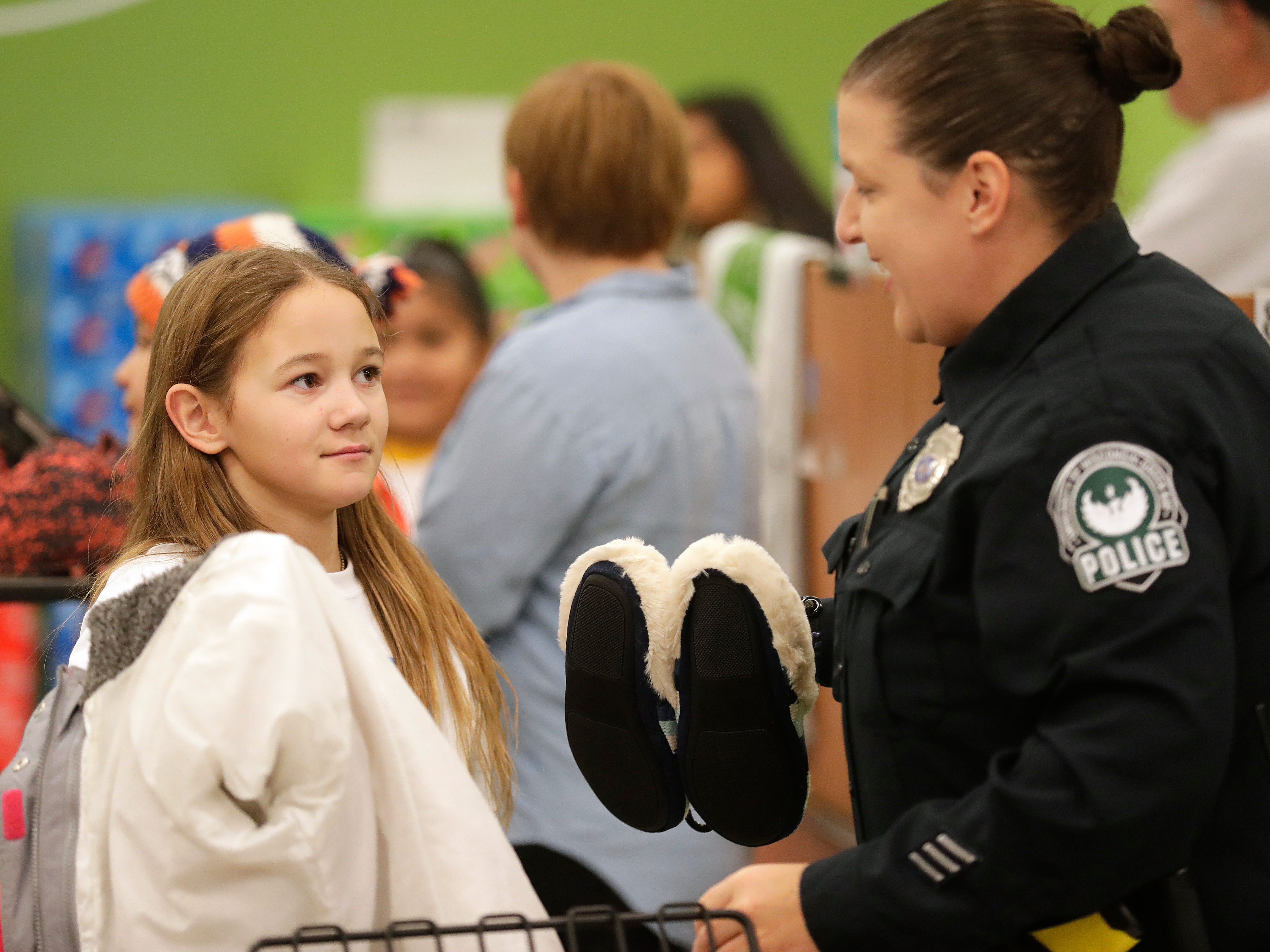 UW-Green Bay Police Department Officer Sabrina Duchateau selects gifts with her Shop with A Cop program kid at Shopko on East Mason Street December 8, 2018 in Green Bay, Wis.