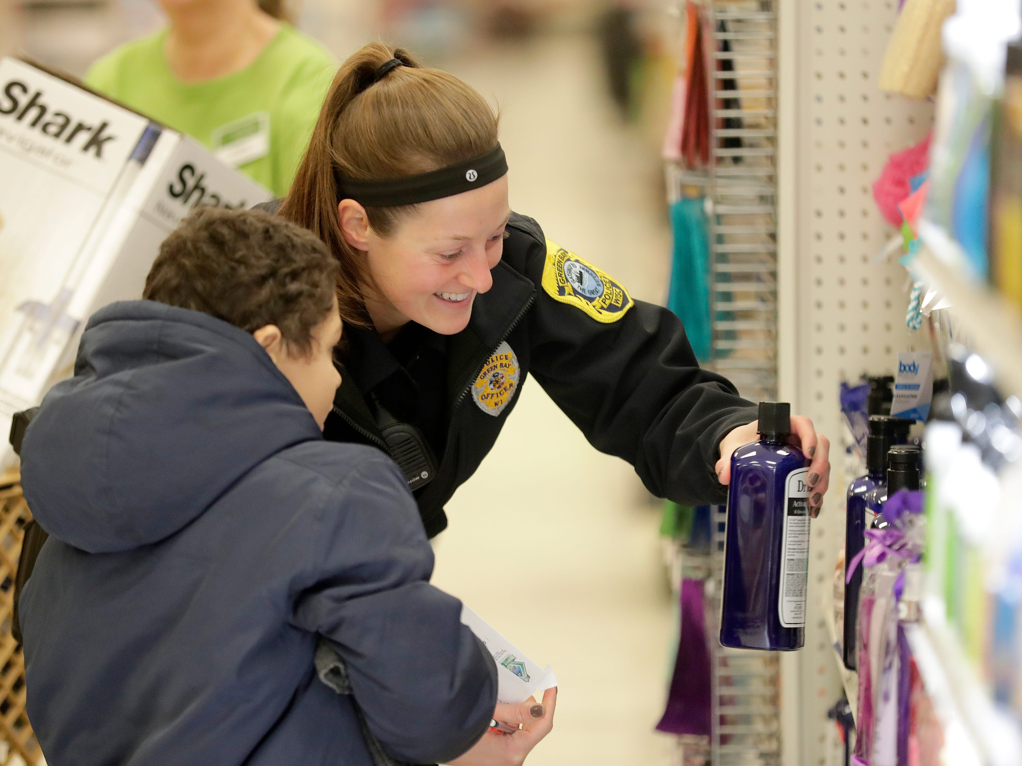Green Bay Police Department Officer Cristey Johnson shops with her Shop with A Cop program kid at Shopko on East Mason Street December 8, 2018 in Green Bay, Wis. This is the 26th year area law enforcement officers have Christmas shopped with kids.
