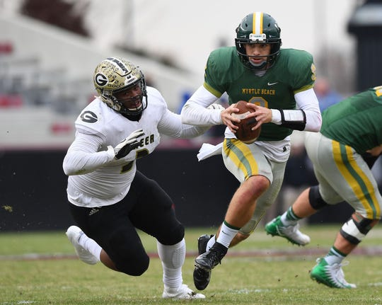 Myrtle Beach quarterback Luke Doty, a USC commit, accounted for 294 yards and three touchdowns in the Seahawks' 38-21 win over Greer during the 2018 Class AAAA state championship game.