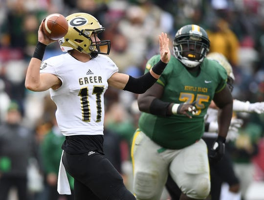 Greer quarterback Matthew Huff (17) threw for 196 yards with three touchdowns in the Yellow Jackets' 37-31 loss to Myrtle Beach Friday.