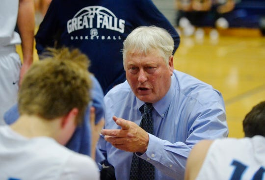 Great Falls High head coach Bob Howard huddles with his players during an early-season basketball game against Flathead High in the Swarthout Fieldhouse.
