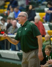 CMR coach John Cislo directs his players on the floor during Friday night's basketball gama against Glacier in the CMR Fieldhouse.