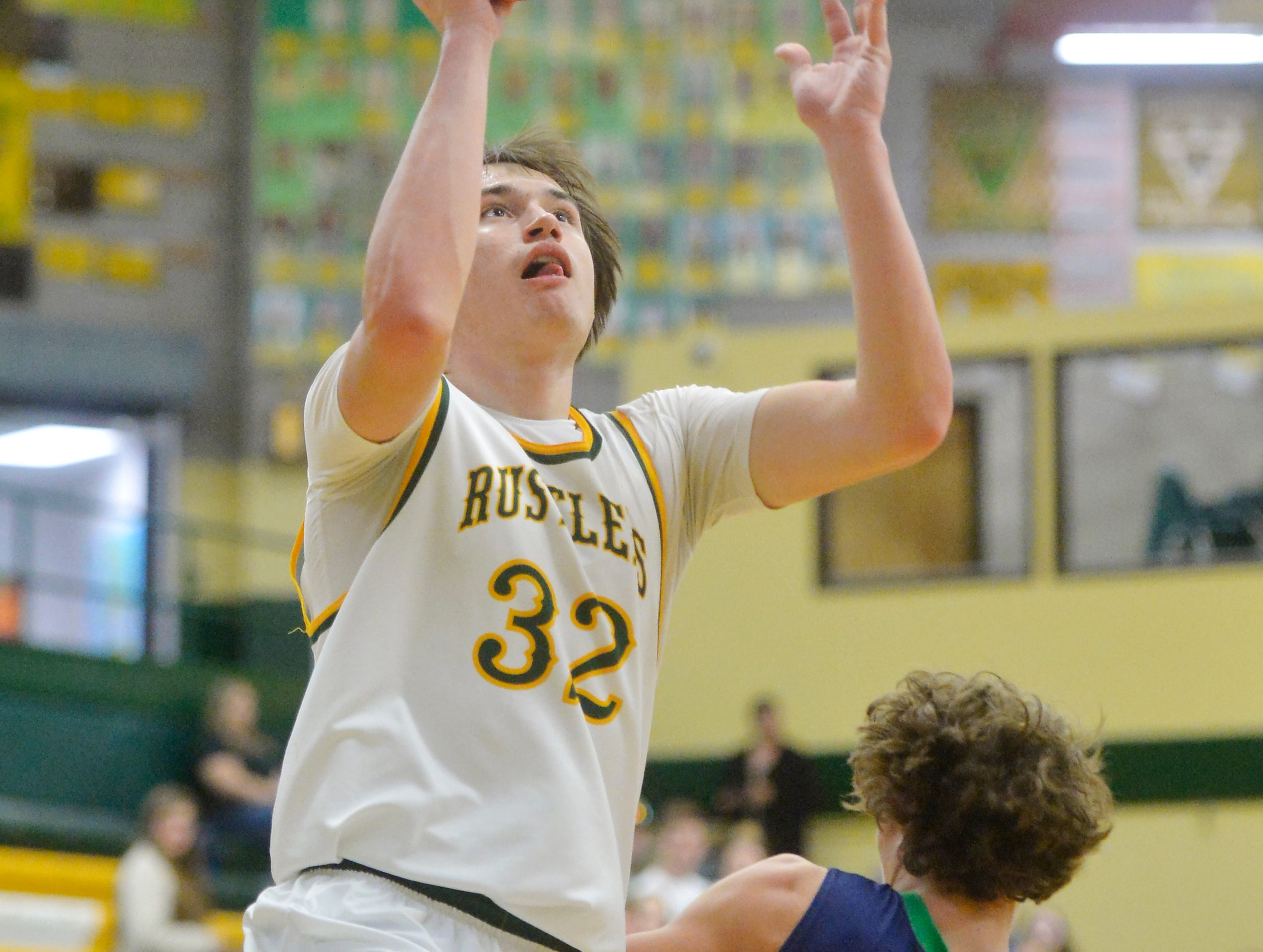 CMR's Bryce Depping goes in for a layup during Friday night's basketball game against Glacier in the CMR Fieldhouse.