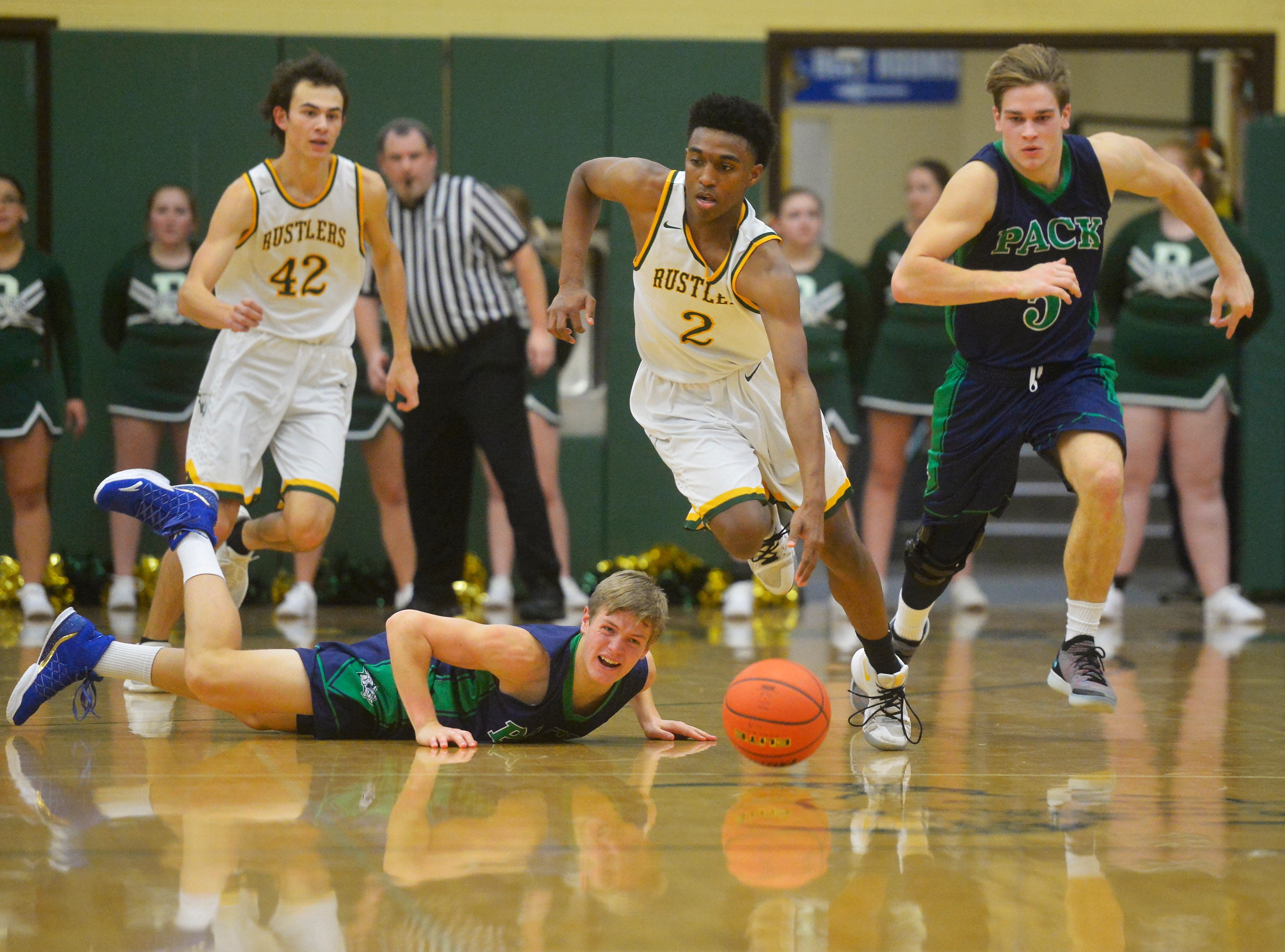 CMR's Caleb Currington makes a steal in Friday night' basketball game against Glacier in the the CMR Fieldhouse.