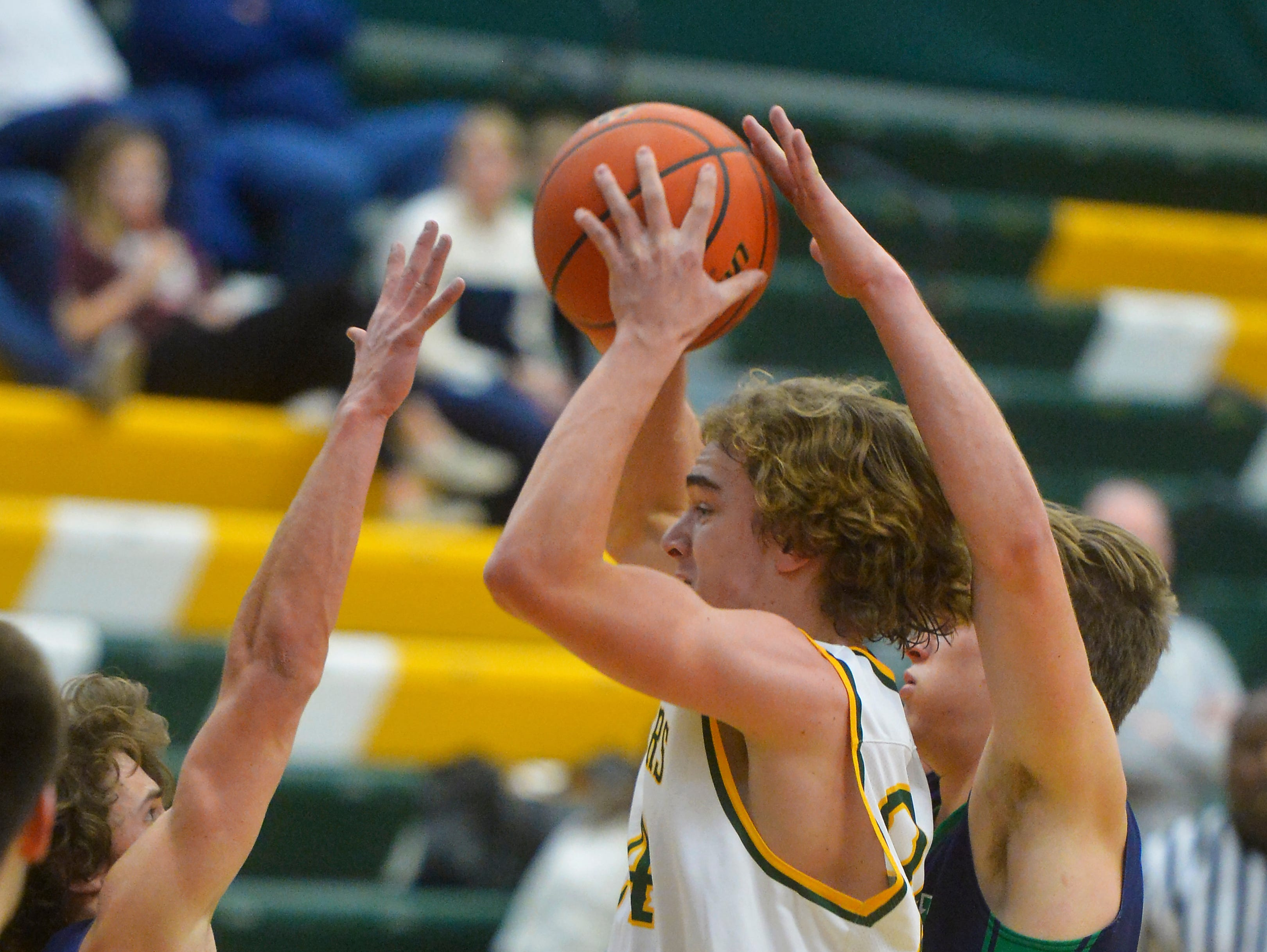 CMR's Kaden Gardner looks for an open teammate during Friday night's basketball game against Glacier in the CMR Fieldhouse.