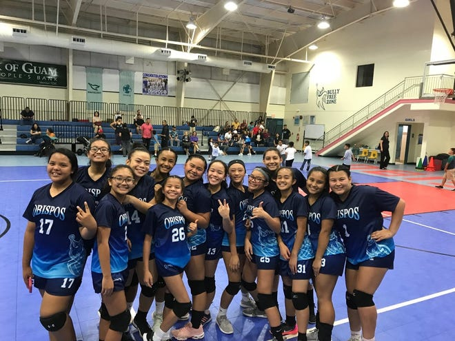 The Bishop Baumgartner Obispos are all smiles after their victory against the San Vicente Braves at their home court.  The Obispos won 25-15, 21-25, 15-0 to move to 8-0 in the Independent Interscholastic Athletic Association of Guam Middle School Girls Volleyball League.  The Braves fall to 4-4 with the loss.