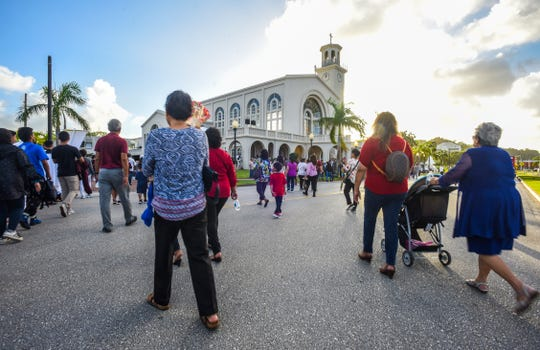 Catholic faithfuls and others celebrate the island's patron saint, Santa Marian Kamalen, or Our Lady of Camarin, in prayer at the Dulce Nombre de Maria Cathedral Basilica and during a procession through the streets of downtown Hagåtña on Saturday, Dec. 8, 2018.