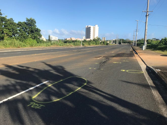 Markings on Gov. Carlos Camacho Road, by Hotel Santa Fe in Tamuning, where a fatal auto-pedestrian accident occurred early Sunday morning.