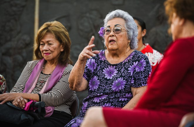 "War survivor Cynthia Tenorio Terlaje, center, shares her memories of as nine-years-old girl during World War II, at the ""Each Name a Life"" commemorative vigil at the War in the Pacific National Historical Park's Asan Bay Overlook on Nimitz Hill on Friday, Dec. 7, 2018. Terlaje recounted when when she was nine-years-old and found alone by a CHamoru man in cave after she was separated from her family during the liberation of the island from Japanese Imperial Forces. Several war survivors, along with a few of their descendents attending the event, shared stories of experiences impacted upon them during the Japanese military occupation of Guam, from December 1941 through July 1944, and the recapturing of the island by American armed forces."