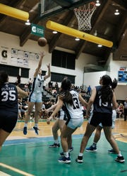 Saint Paul Warriors' Monica Giger shoots the ball during the IIAAG Girl's basketball championship game against the Academy of Our Lady of Guam Cougars at the University of Guam Calvo Fieldhouse December 7, 2018.