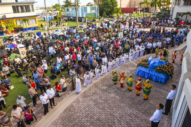 Catholic faithful gather on the lawn of the Dulce Nombre de Maria Cathedral Basilica in prayer and preparation for the annual Santa Marian Kamalen, or Our Lady of Camarin, procession through Hagåtña in this Dec. 8, 2018, file photo.