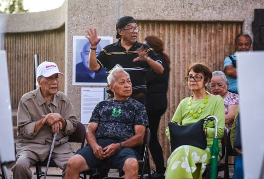 "CHamoru language educator Peter Onedera shares a World War II experience, passed on to him by his aunt and sister, during the ""Each Name a Life"" commemorative vigil at the War in the Pacific National Historical Park's Asan Bay Overlook on Nimitz Hill on Friday, Dec. 7, 2018. Onedera shared how young boys would help protect the island's female population from Japanese soliders by serving as lookouts during their military occupation from December 1941 through July 1944. Several war survivors, along with their descendents attending the event, shared stories of experiences impacted upon them during the Japanese military occupation of Guam, from December 1941 through July 1944, and the recapturing of the island by American armed forces."