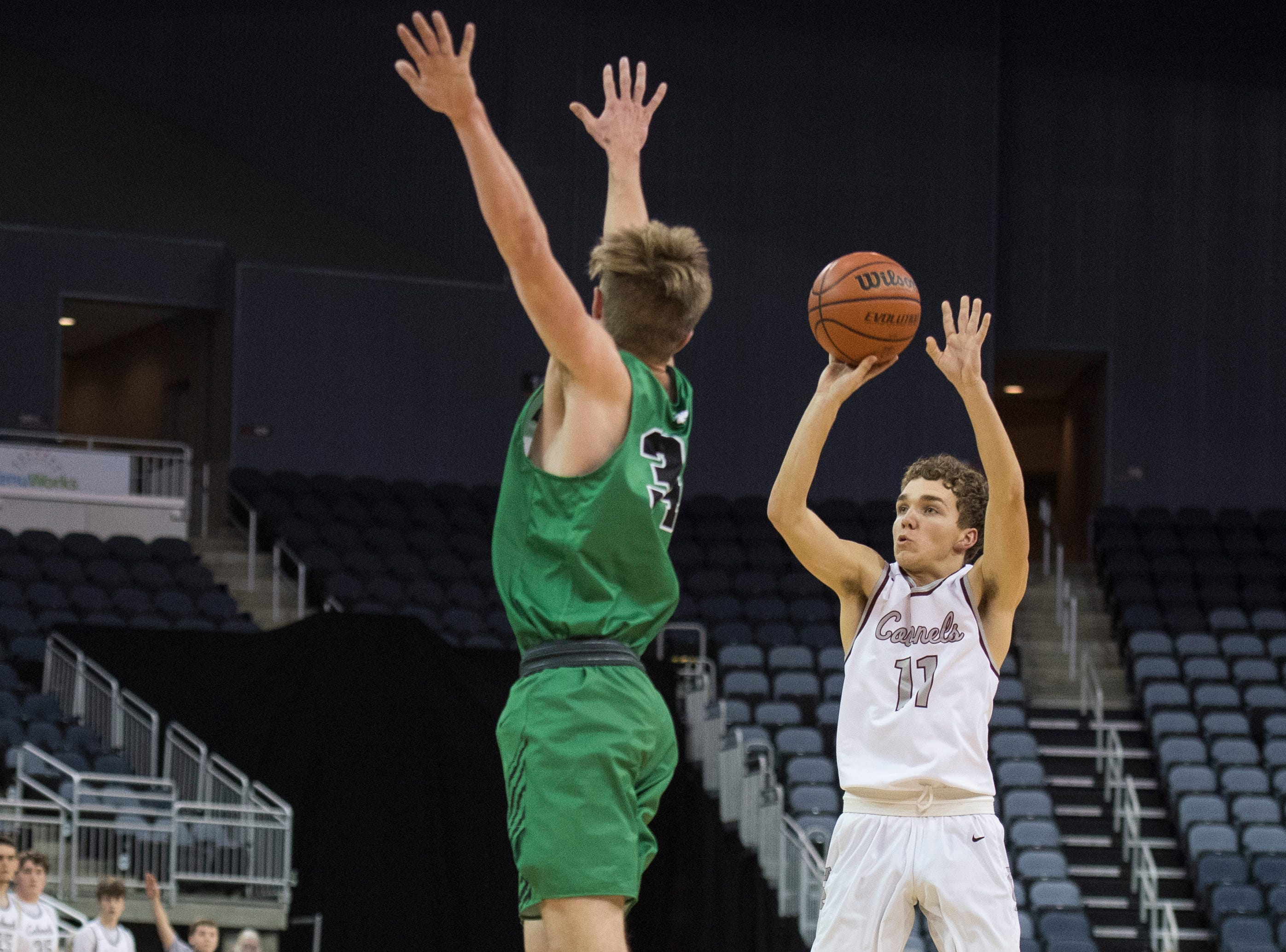 Henderson's Luke Fulkerson (11) takes a jump shot during the Henderson County vs Evansville North basketball game in the River City Showcase at the Ford Center Friday, Dec. 7, 2018.