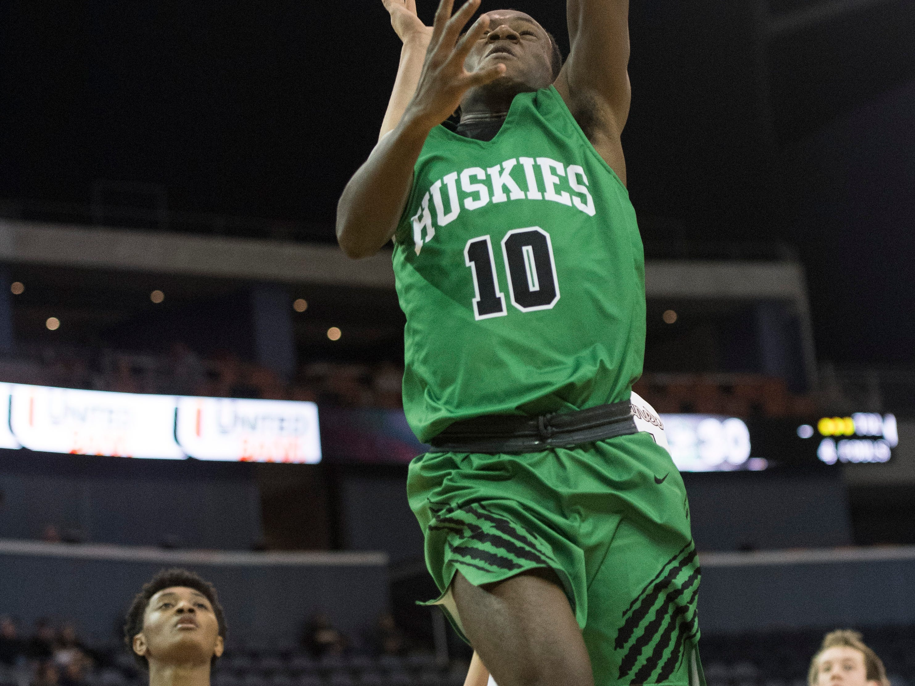 Henderson's DJ Mitchell (10) takes a shot during the Henderson County vs Evansville North basketball game in the River City Showcase at the Ford Center Friday, Dec. 7, 2018.