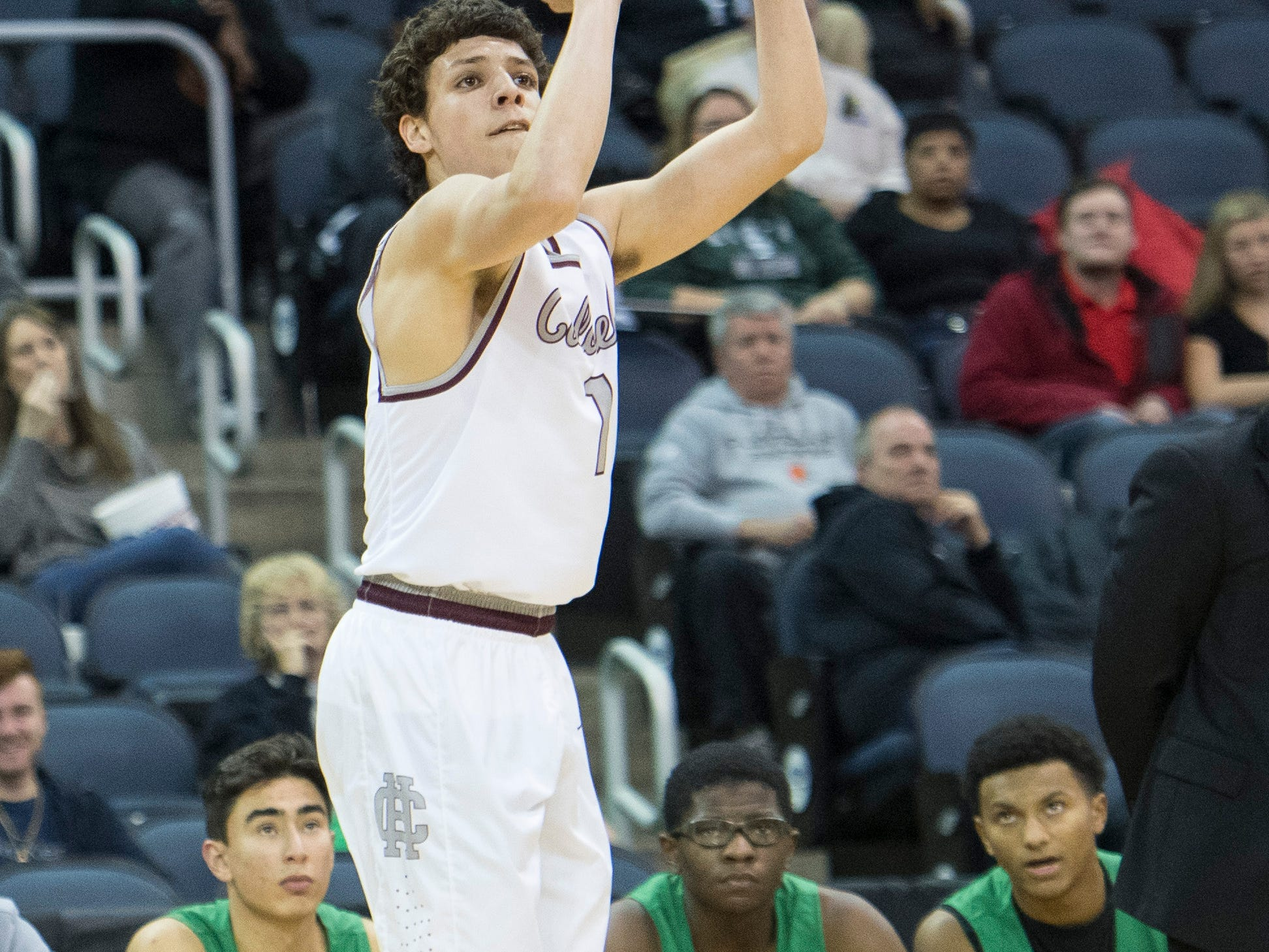Henderson's Corey Stewart (1) takes a shot from the 3-point line during the Henderson County vs Evansville North basketball game in the River City Showcase at the Ford Center Friday, Dec. 7, 2018.