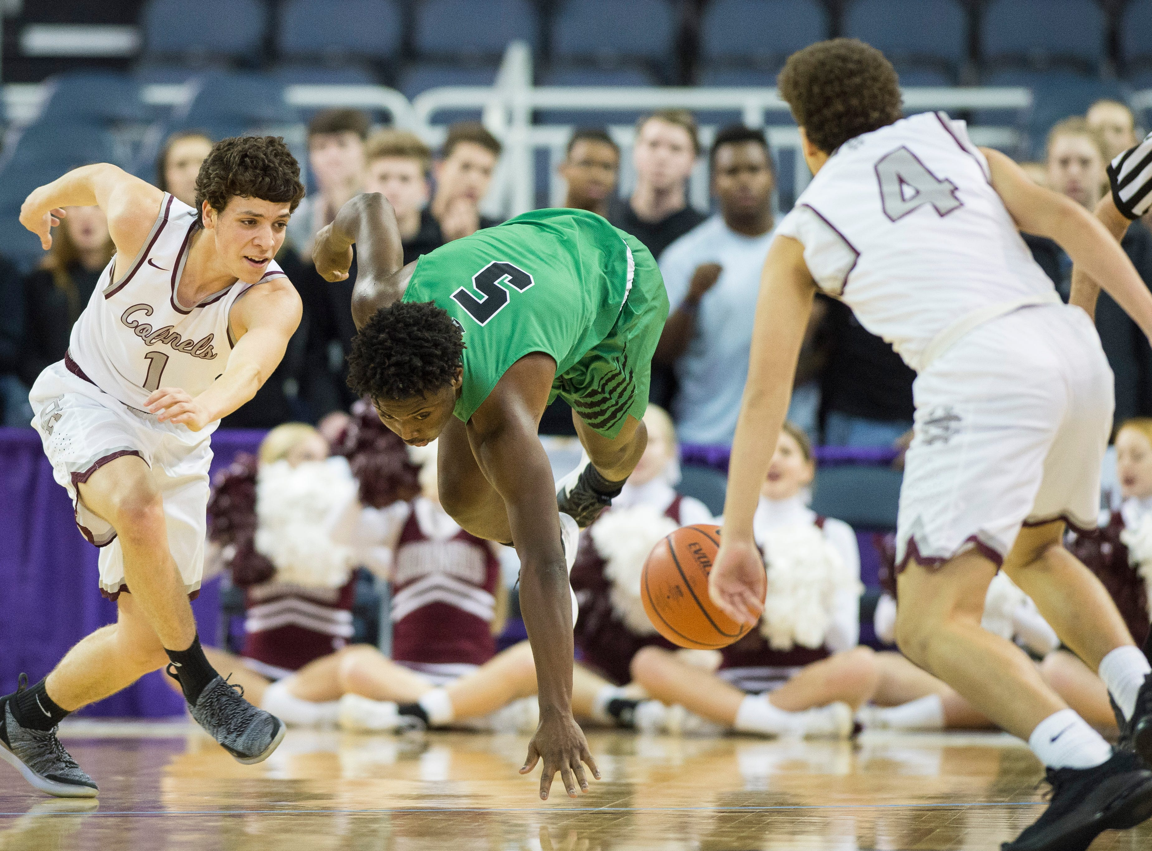North's JT Skinner (5) and Henderson's Corey Stewart (1) chase after the ball during the Henderson County vs Evansville North basketball game in the River City Showcase at the Ford Center Friday, Dec. 7, 2018.