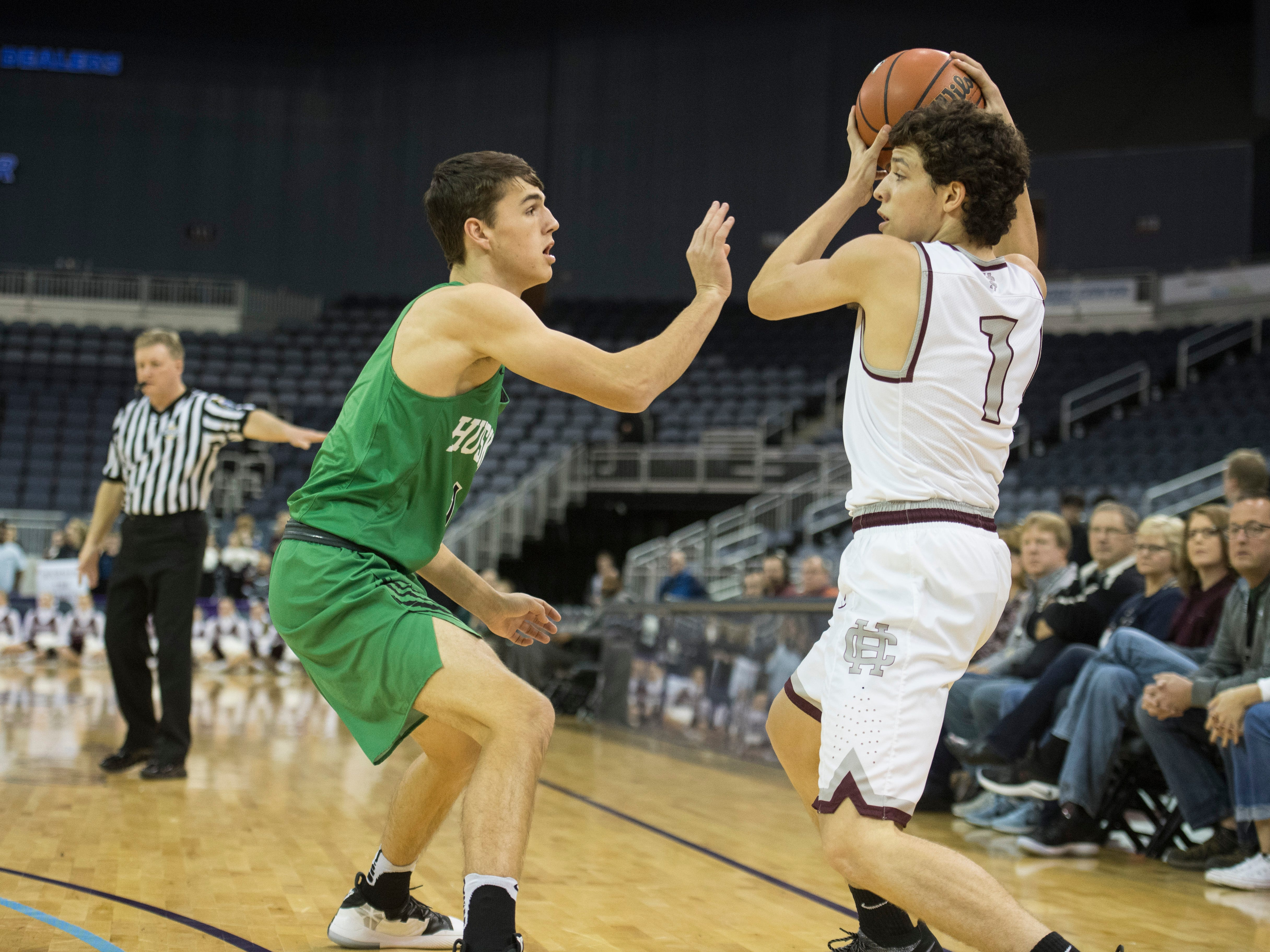 Henderson's Corey Stewart (1) looks for an open man to pass the ball during the Henderson County vs Evansville North basketball game in the River City Showcase at the Ford Center Friday, Dec. 7, 2018.
