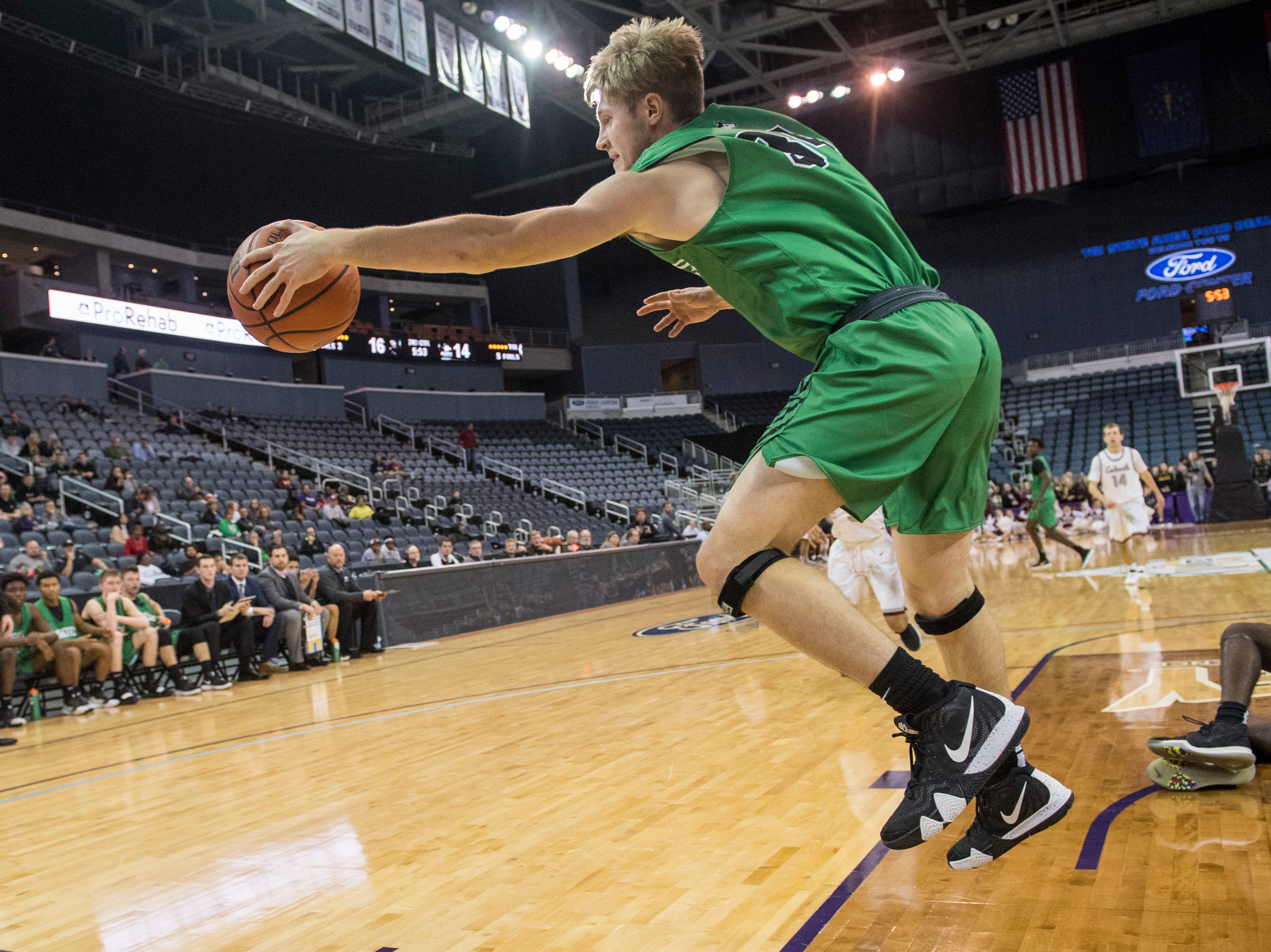 North's Adam Bury (34) saves the ball from going out-of-bounds during the Henderson County vs Evansville North basketball game in the River City Showcase at the Ford Center Friday, Dec. 7, 2018.