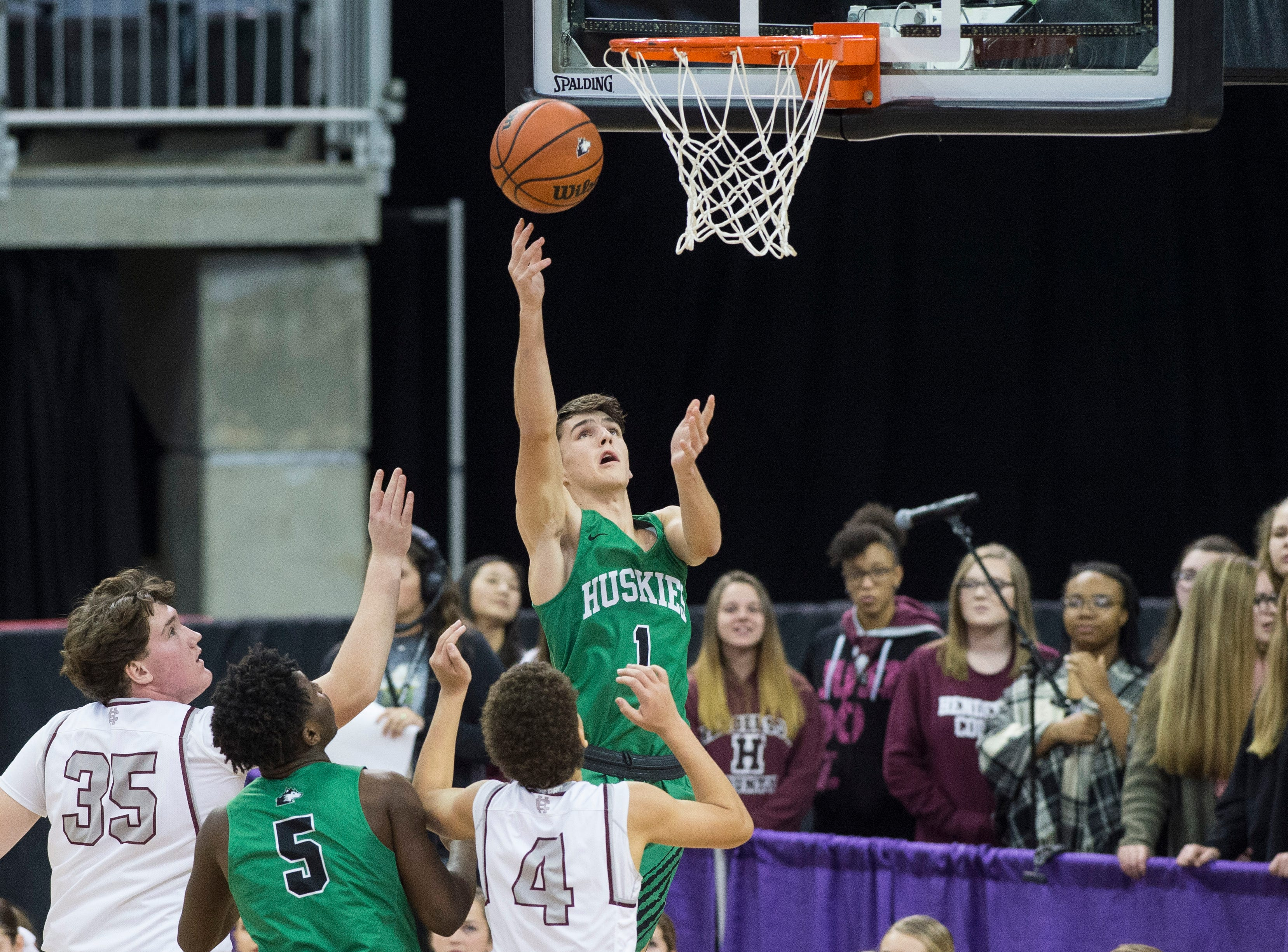 North's Seth Seniour (1) takes a shot during the Henderson County vs Evansville North basketball game in the River City Showcase at the Ford Center Friday, Dec. 7, 2018.