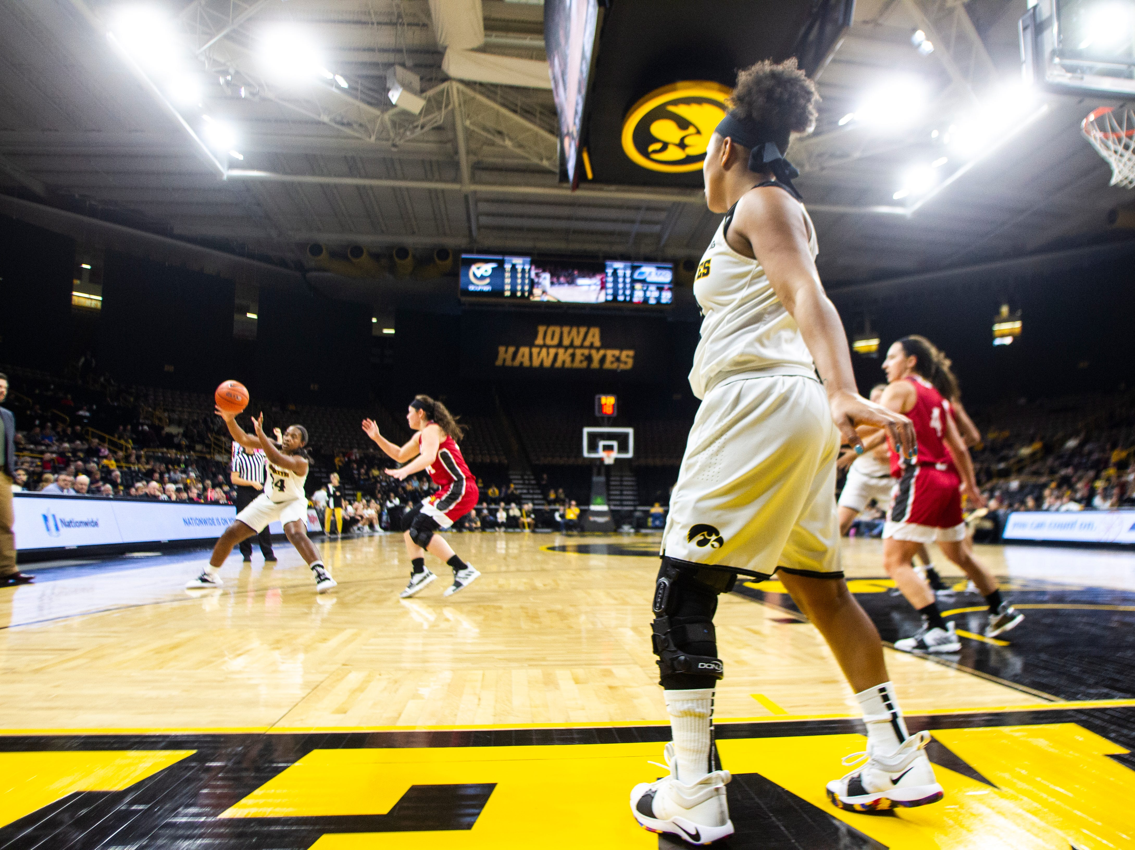 Iowa guard Tania Davis (11) inbounds the ball to Iowa guard Zion Sanders (24) during a NCAA women's basketball game on Saturday, Dec. 8, 2018, at Carver-Hawkeye Arena in Iowa City.