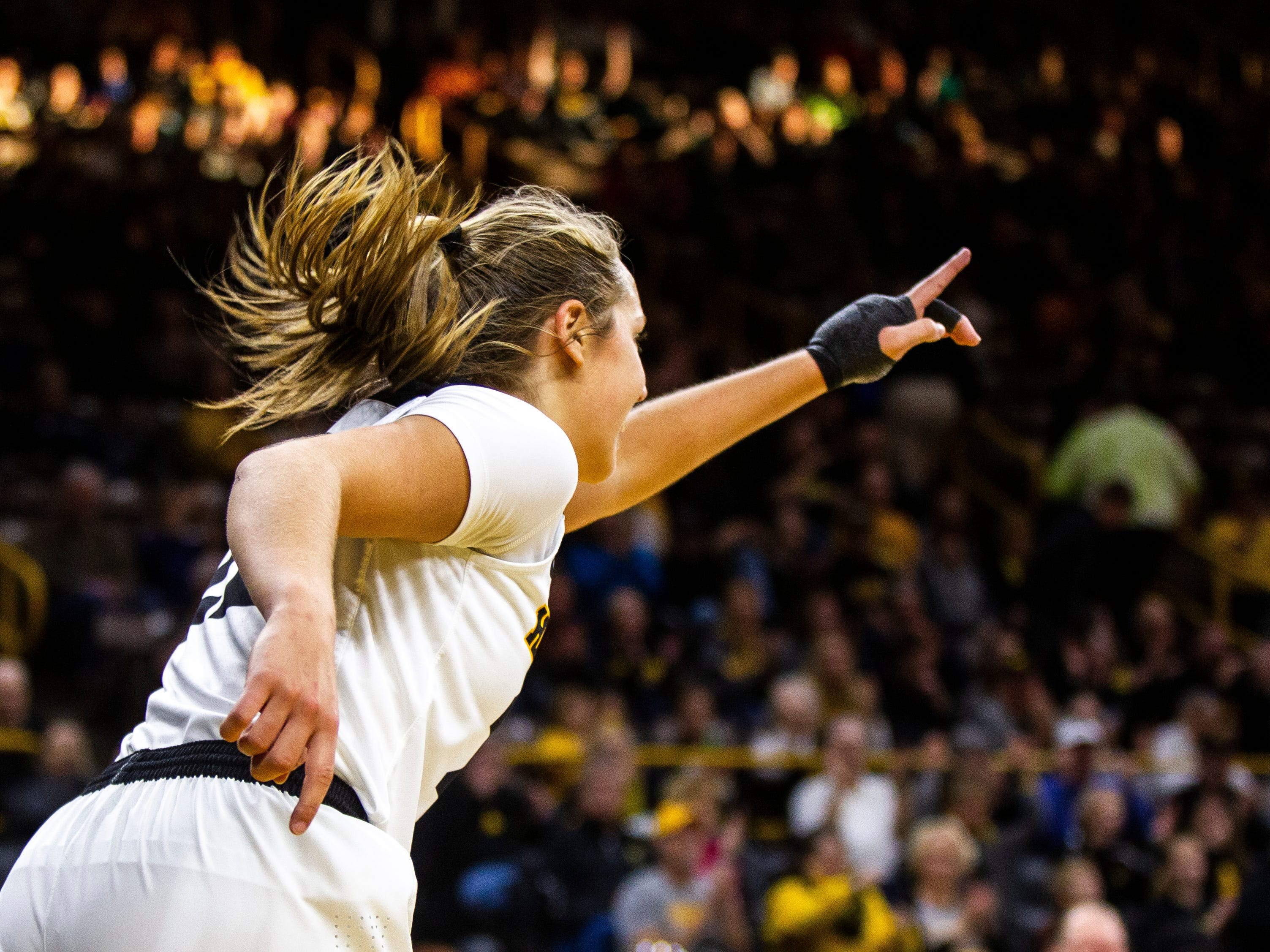 Iowa guard Kathleen Doyle (22) reacts after making a basket during a NCAA women's basketball game on Saturday, Dec. 8, 2018, at Carver-Hawkeye Arena in Iowa City.