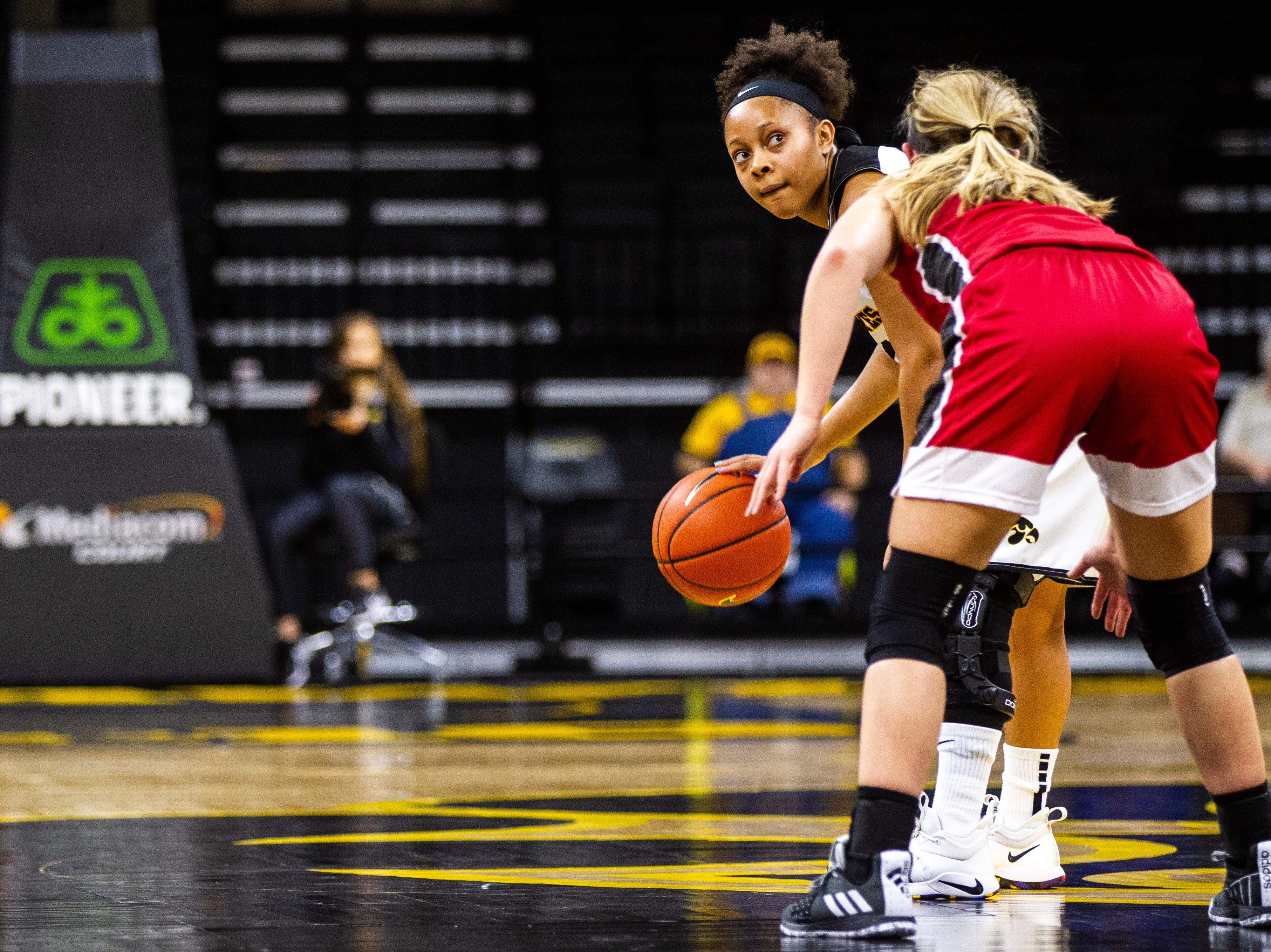 Iowa guard Tania Davis (11) watches as the shot clock winds down during a NCAA women's basketball game on Saturday, Dec. 8, 2018, at Carver-Hawkeye Arena in Iowa City.