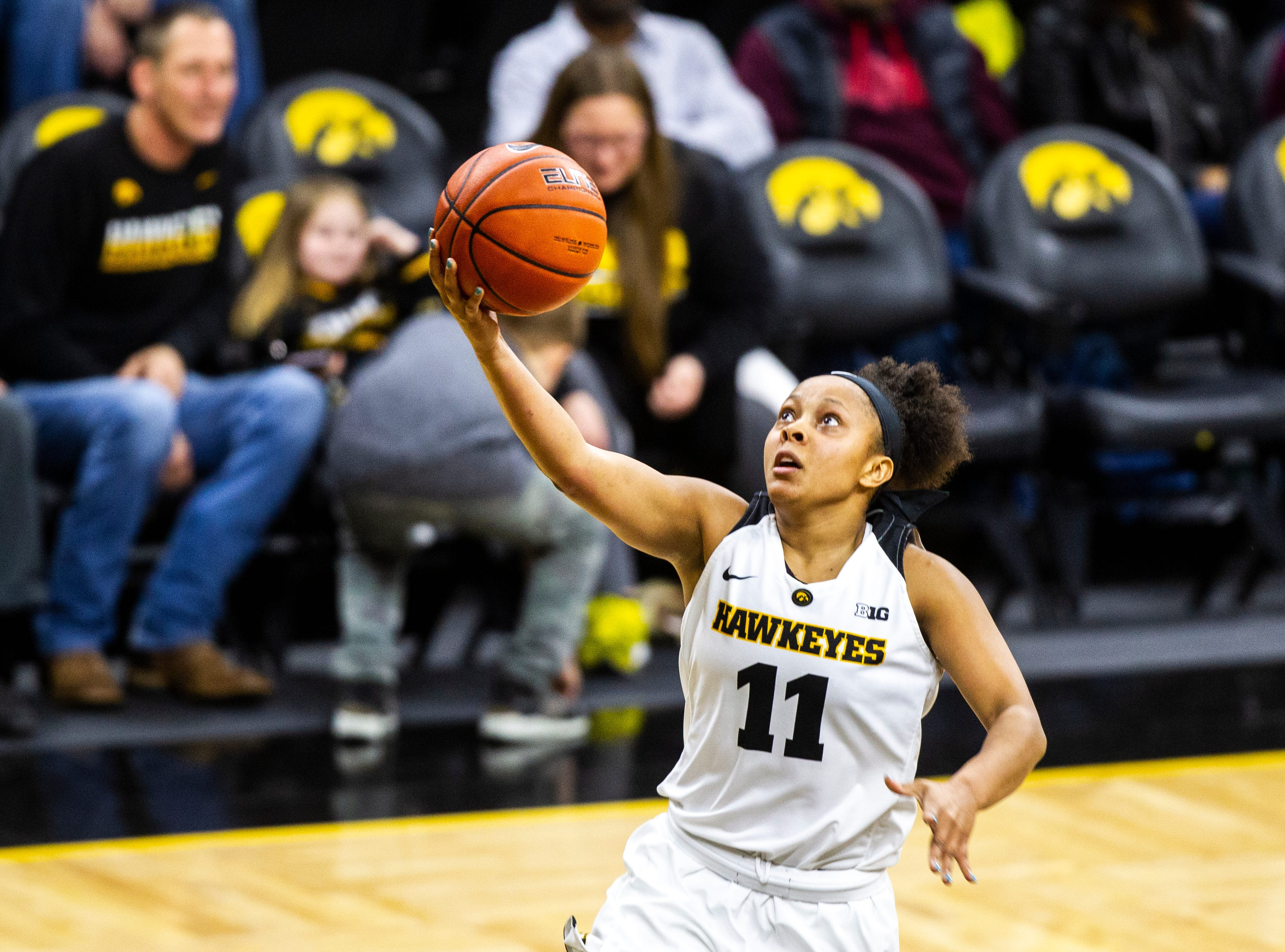 Iowa guard Tania Davis (11) makes a basket during a NCAA women's basketball game on Saturday, Dec. 8, 2018, at Carver-Hawkeye Arena in Iowa City.