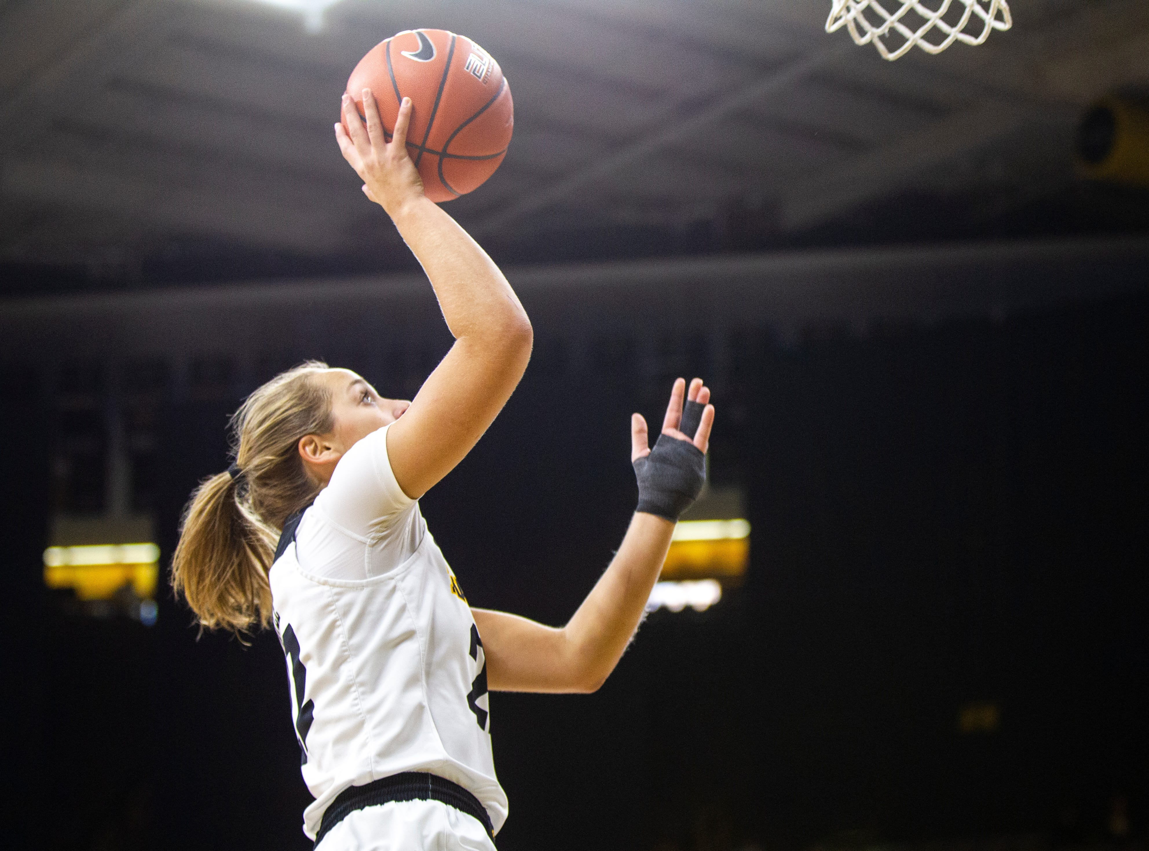 Iowa guard Kathleen Doyle (22) makes a basket during a NCAA women's basketball game on Saturday, Dec. 8, 2018, at Carver-Hawkeye Arena in Iowa City.