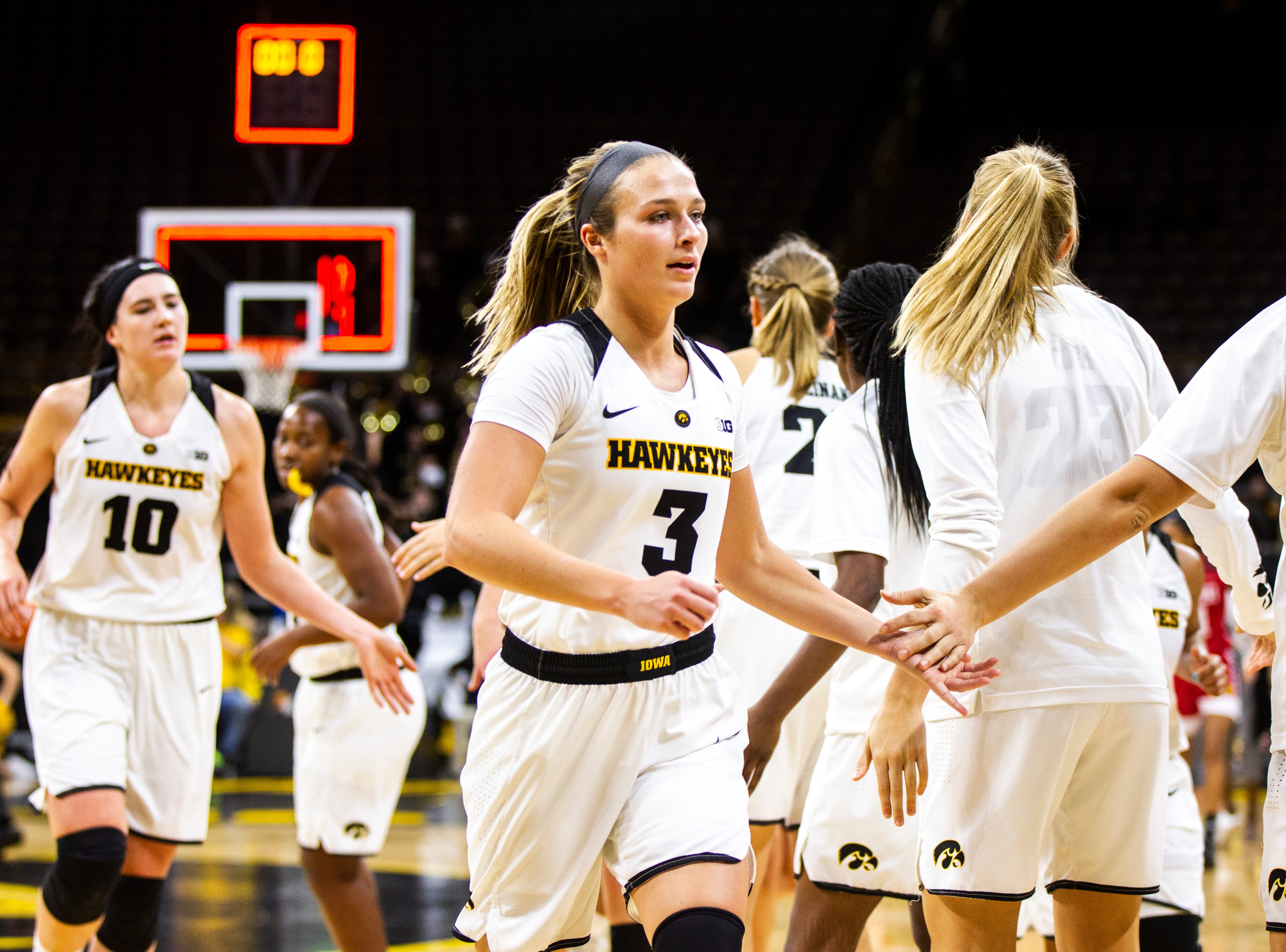 Iowa guard Makenzie Meyer (3) high-fives teammates heading into halftime after making a 3-point basket at the buzzer during a NCAA women's basketball game on Saturday, Dec. 8, 2018, at Carver-Hawkeye Arena in Iowa City.