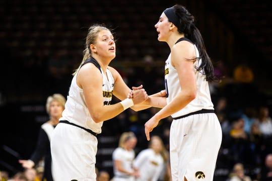 Iowa's Monika Czinano (left) talks with Iowa forward Megan Gustafson (10) during a NCAA women's basketball game on Saturday, Dec. 8, 2018, at Carver-Hawkeye Arena in Iowa City.